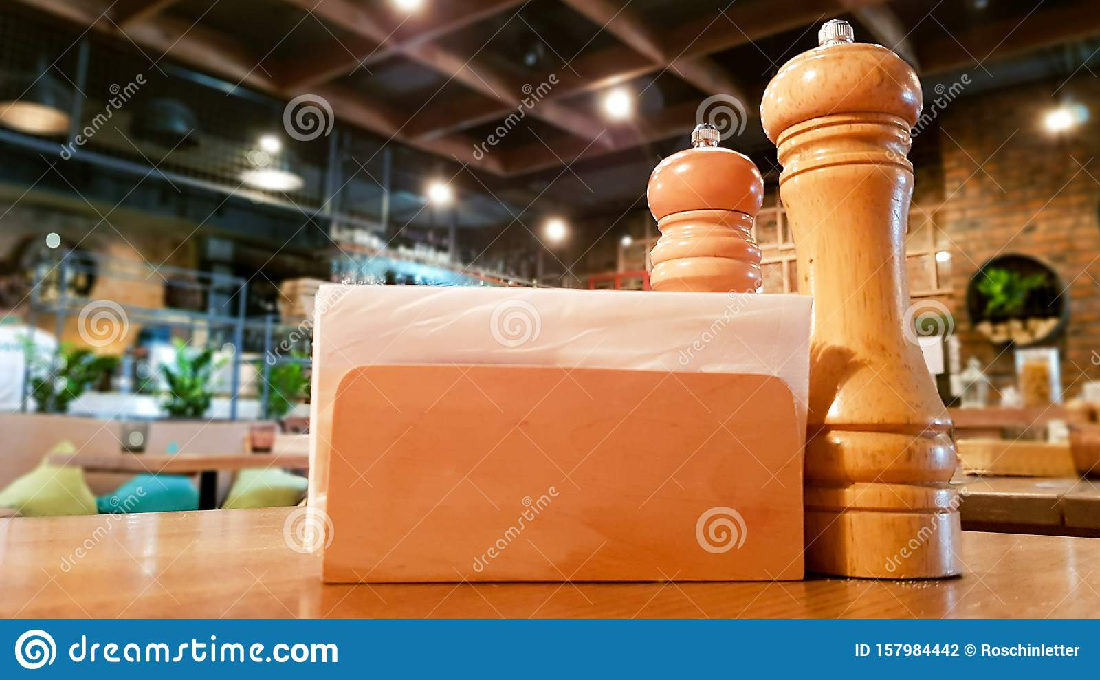 A Table In A Cafe Or Restaurant White Napkins In A Wooden Napkin Holder Spices Salt And Pepper On A Wooden Table Panoramic View Stock Photo Image Of Paper Clean 157984442