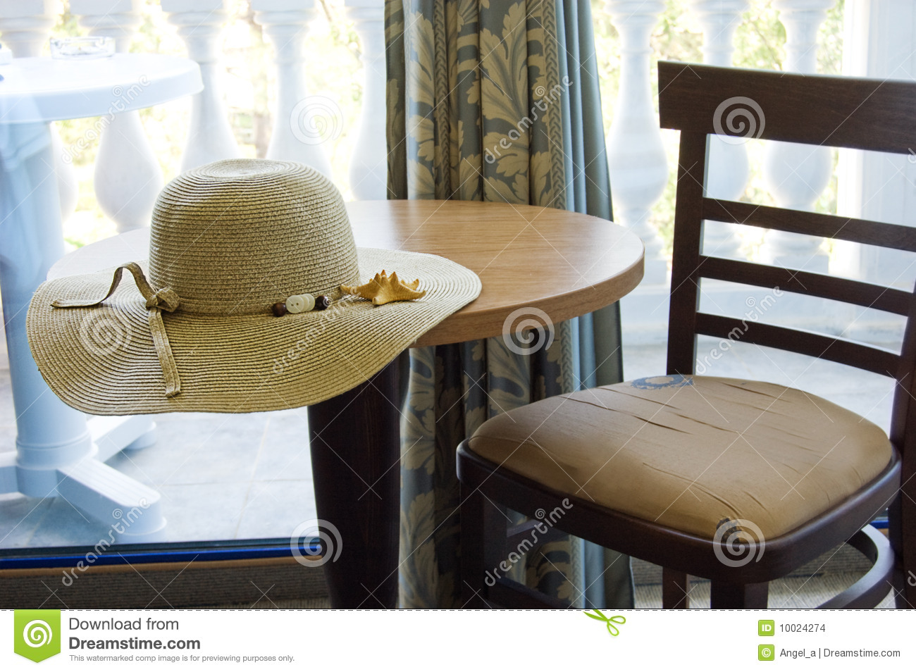 Table and chair in hotel room