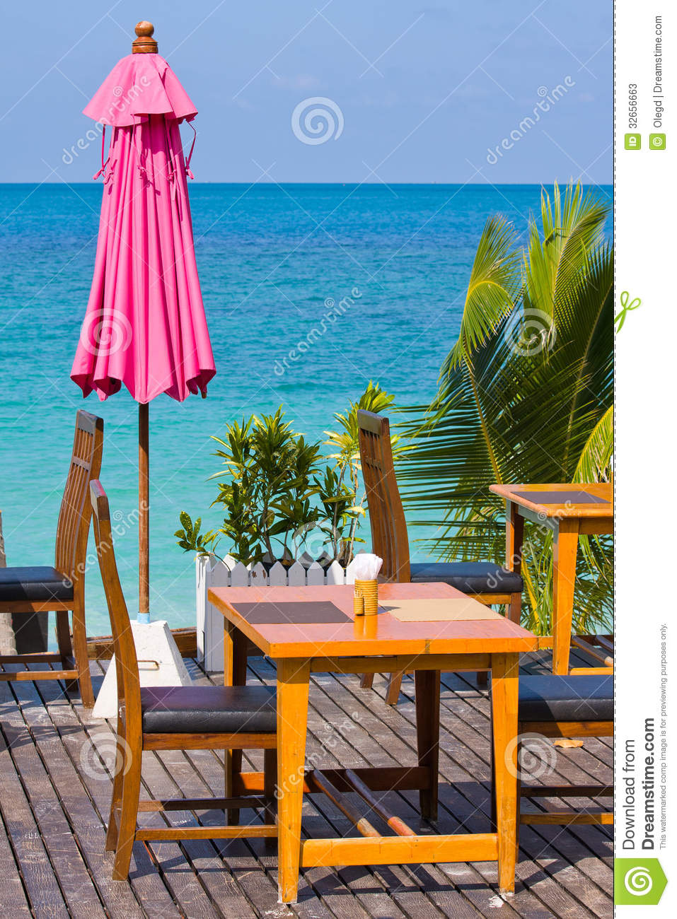 Table and chairs on the beach stock photos image 32656663 for Table 99 koh samui