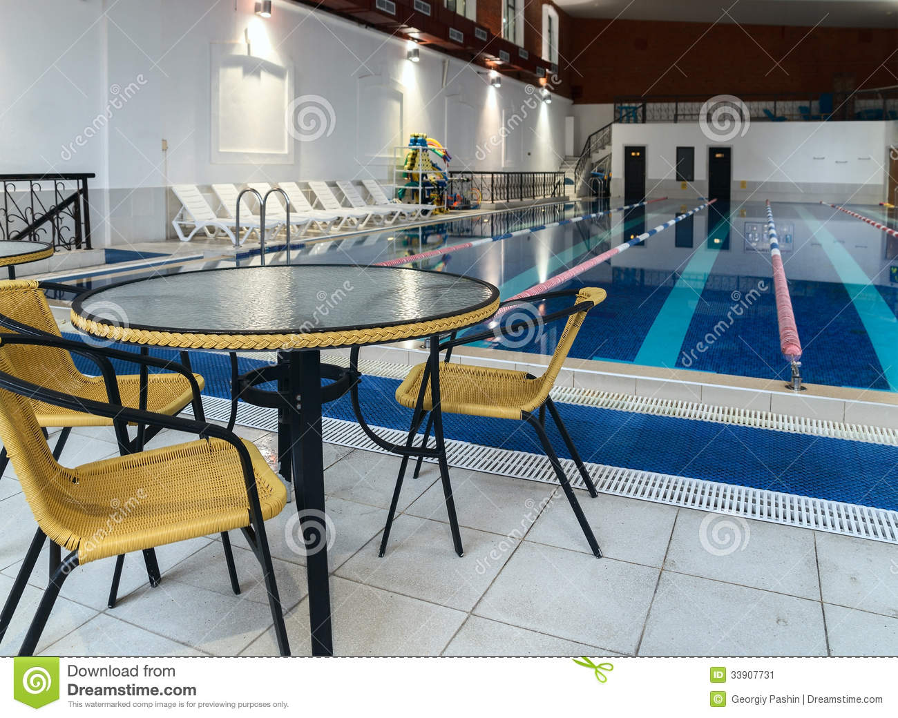 Table And Chairs Near Swimming Pool Stock Image Image 33907731