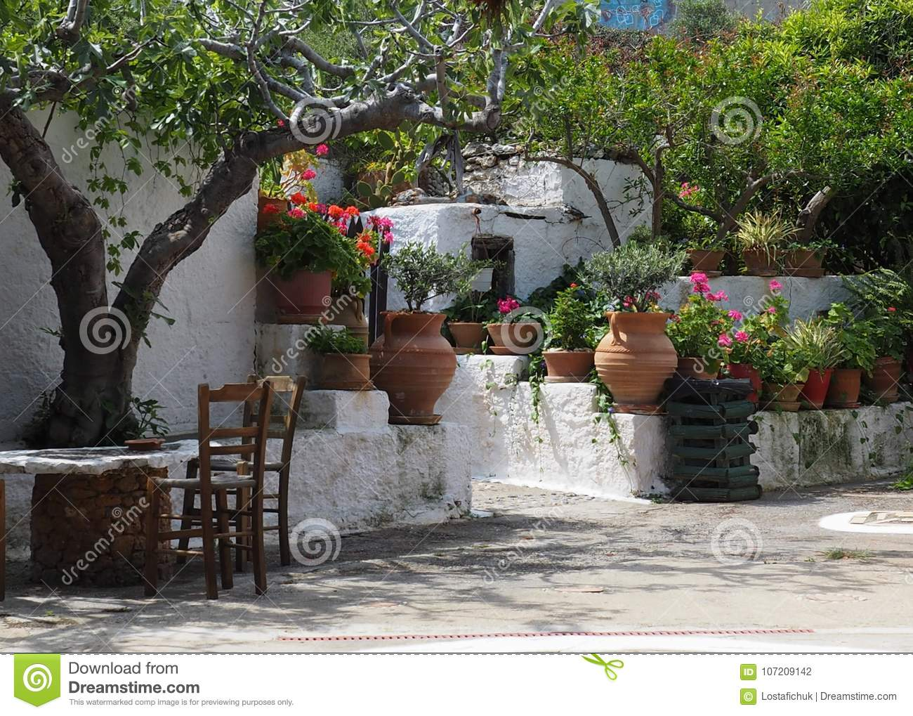 Table And Chairs On Patio In Crete Greece Stock Photo Image Of