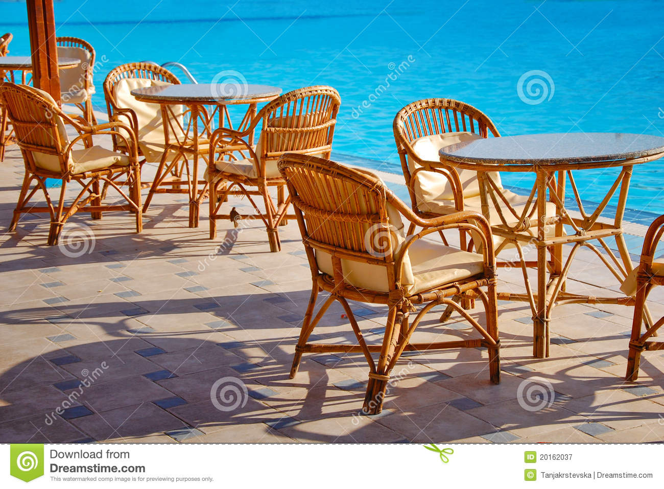 Table and chairs by the pool royalty free stock for Poolside table and chairs