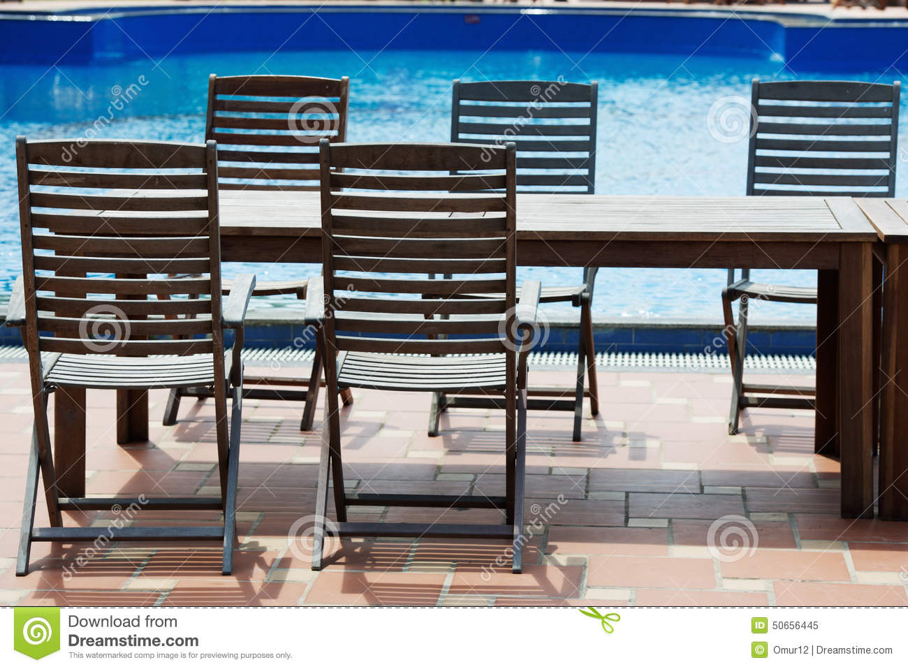 Table and chairs on poolside stock photo image 50656445 for Poolside table and chairs