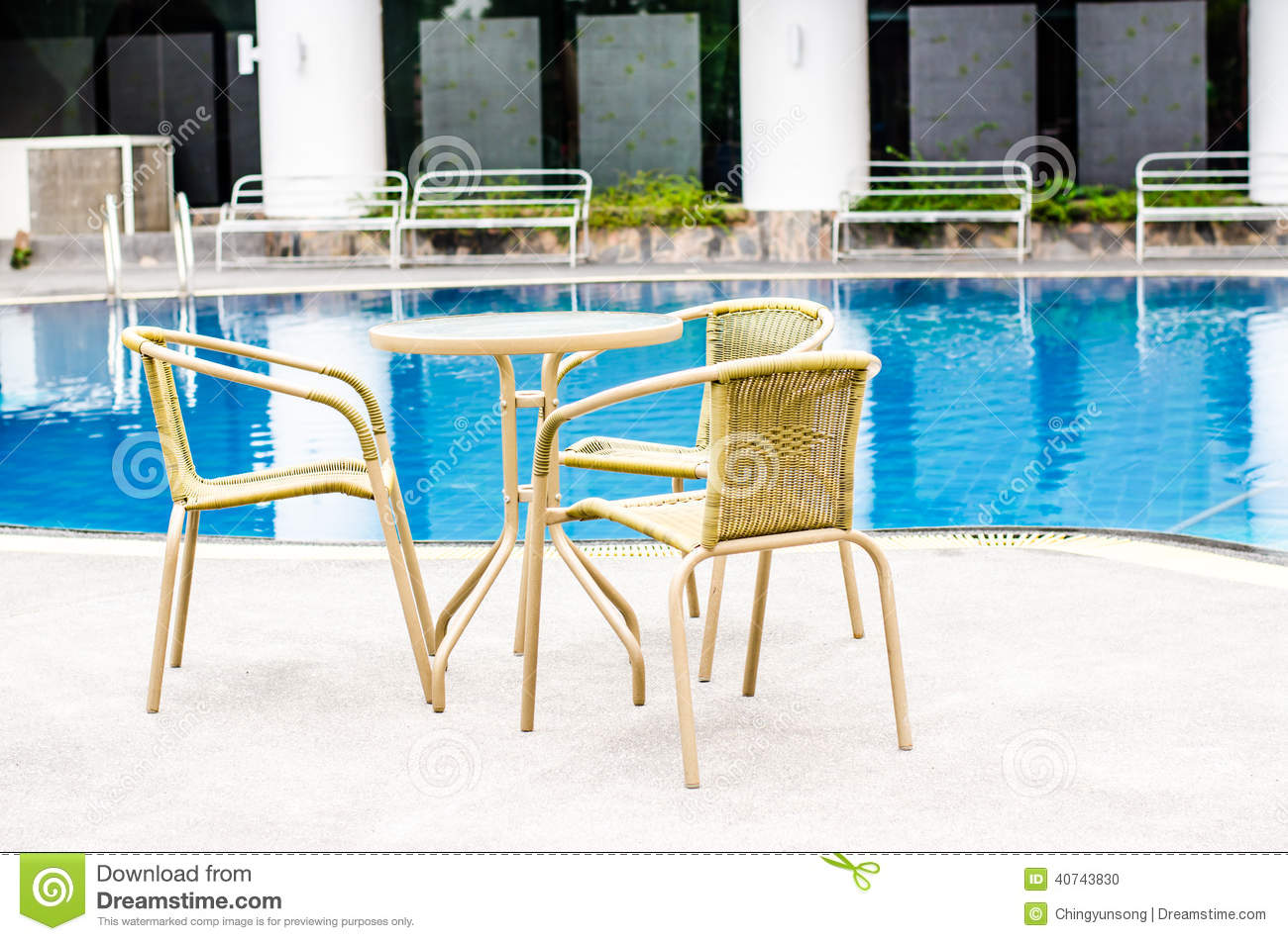 Table and chairs with swimming pool stock photo image for Poolside table and chairs