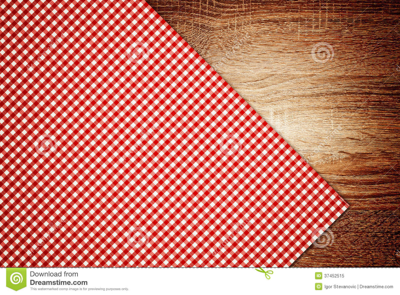 Table cloth, kitchen napkin on wooden table as background.