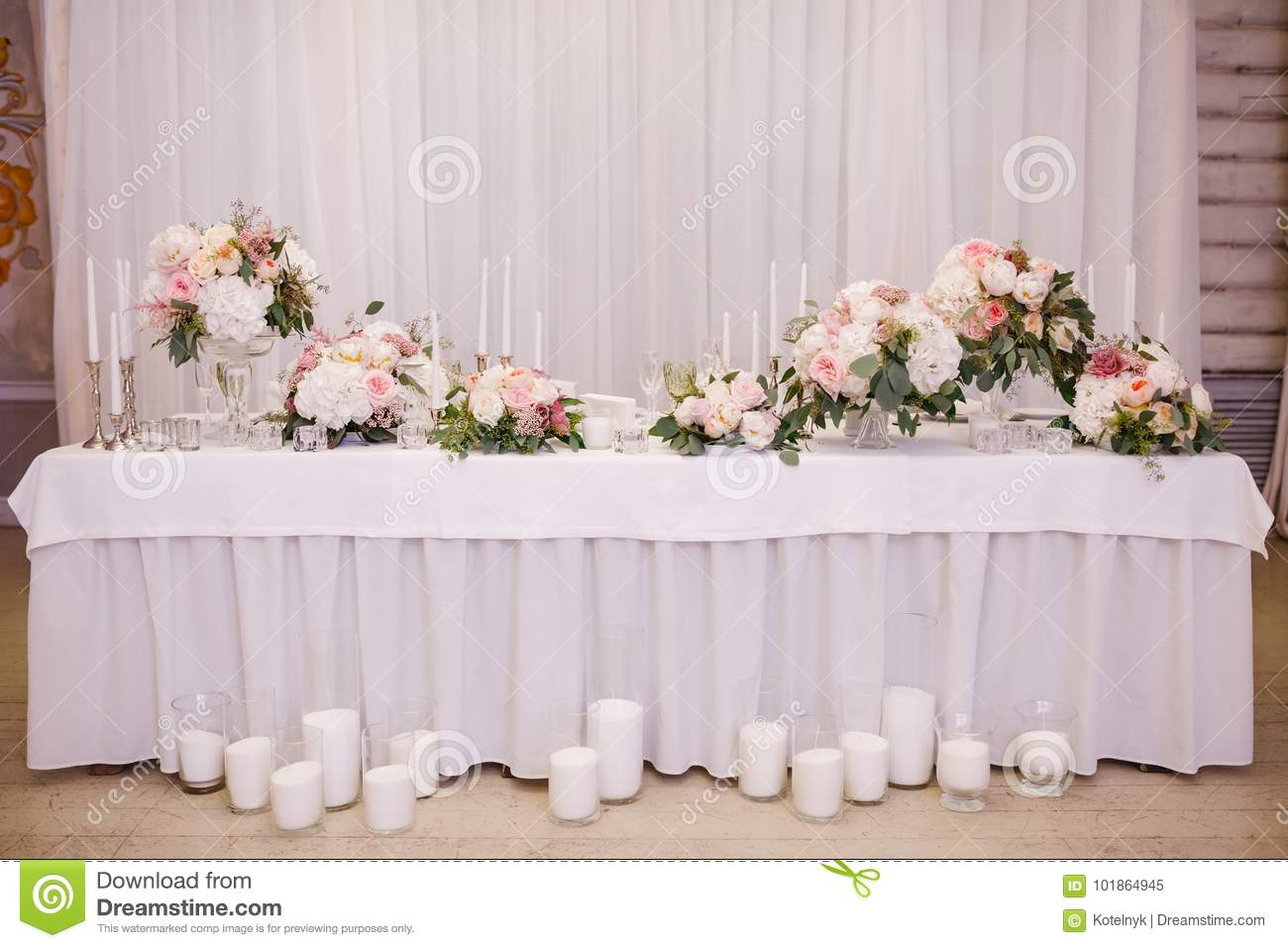 Table decor with white flowers and candles for a wedding party stock table decor with white and pink flowers and candles for a wedding party in a restaurant mightylinksfo