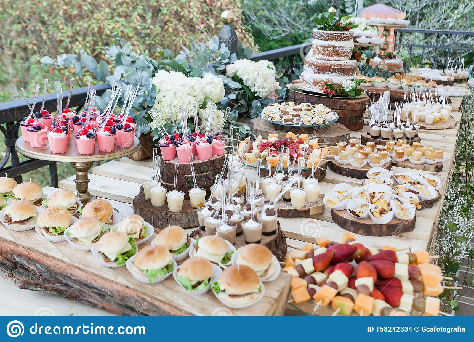 Table Decorated With Desserts Snacks And Cake Wedding Reception