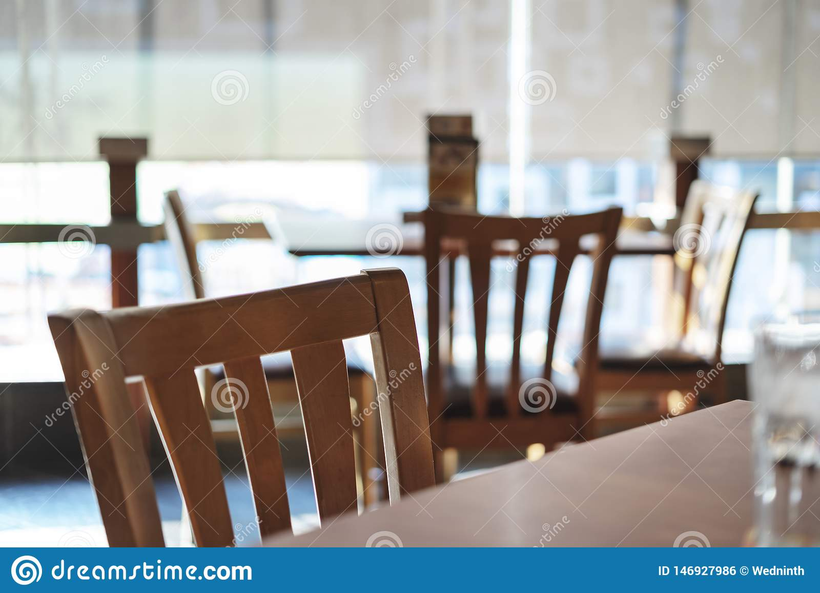 Table and empty chair Interior of a modern restaurant or bar