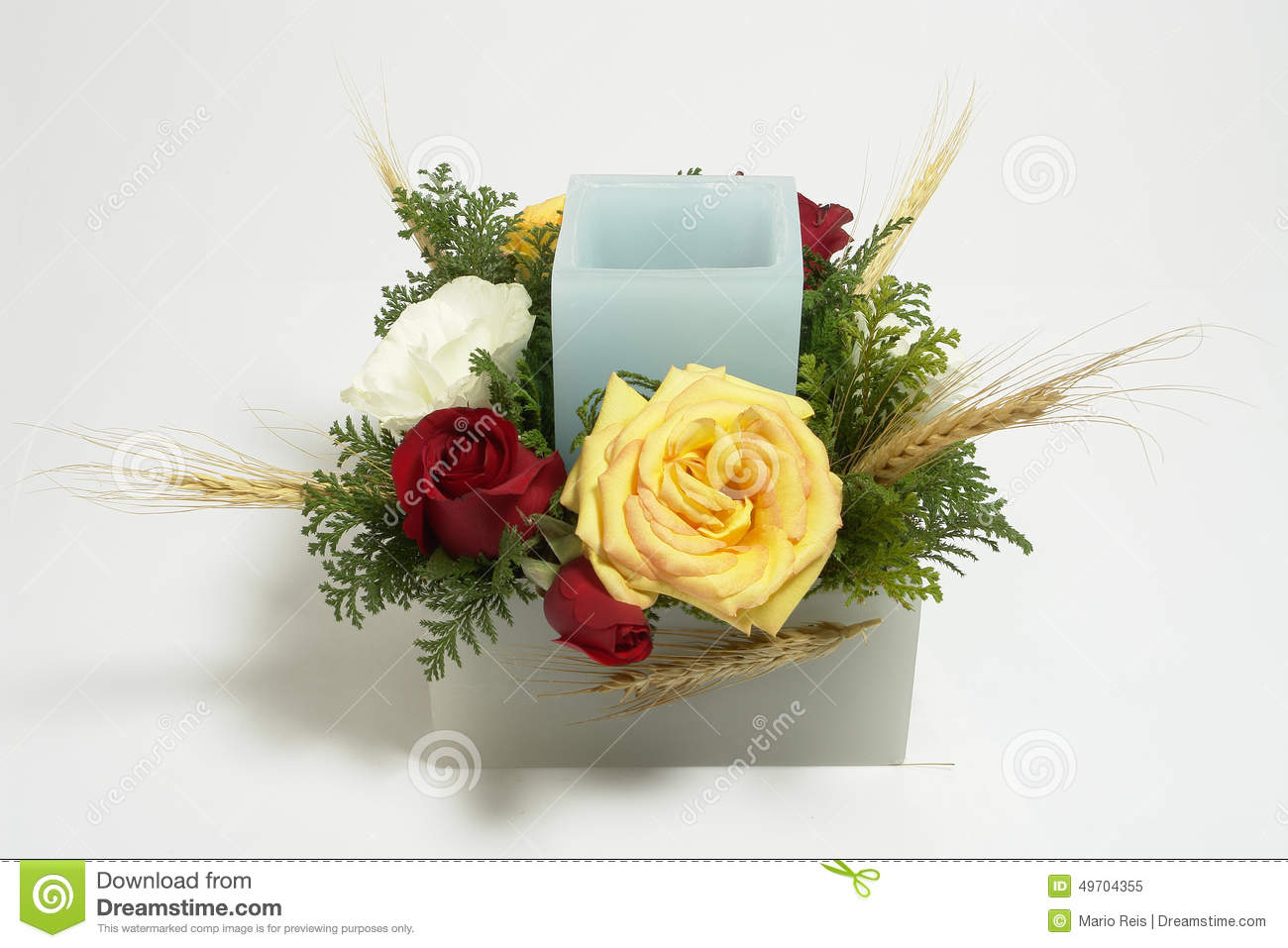 Table Floral Arrangement With Candle And Roses Stock Photo