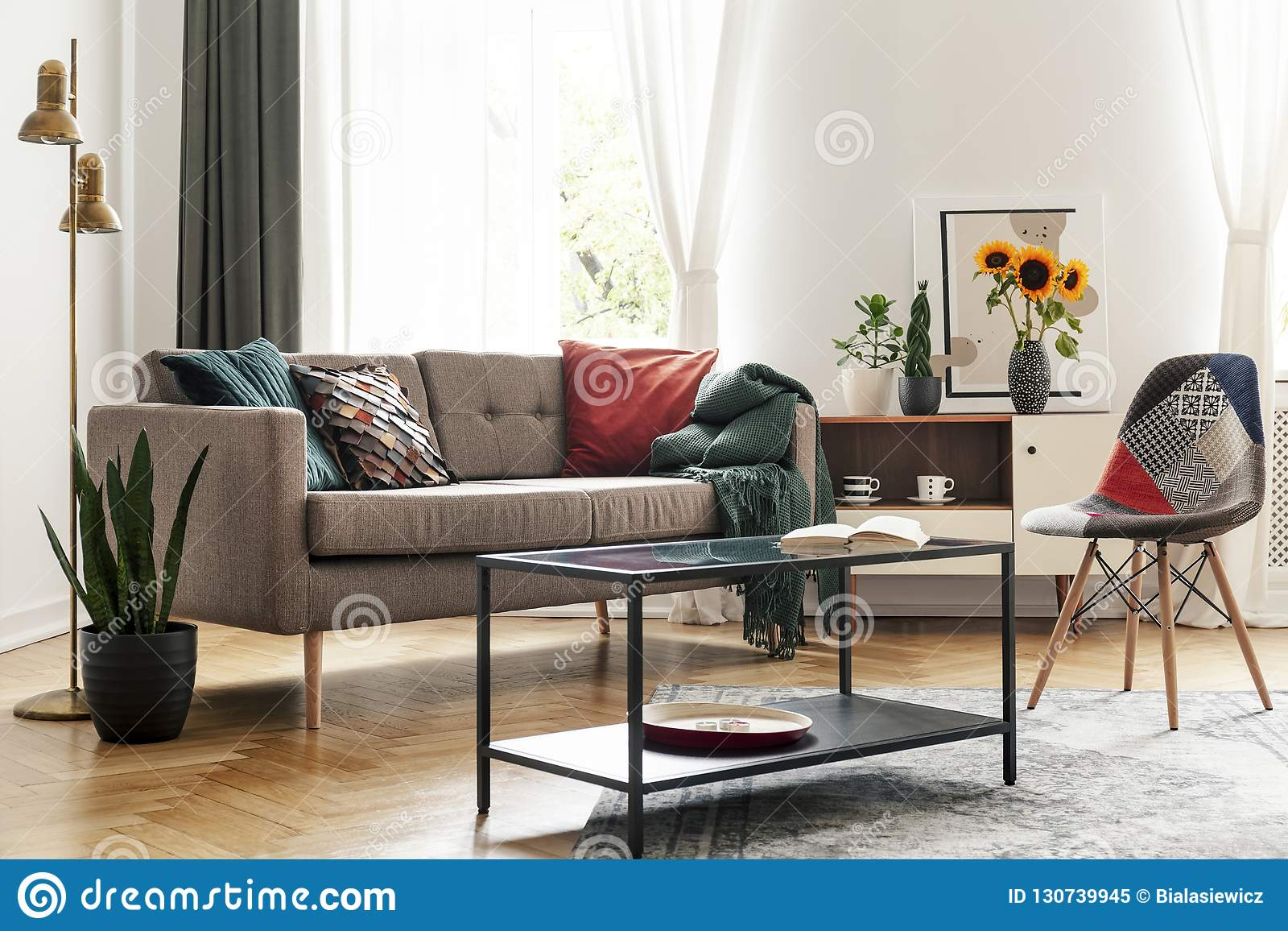 table in front of chair and sofa in living room interior real photo rh dreamstime com round coffee table in front of sofa white sofa table in front of window