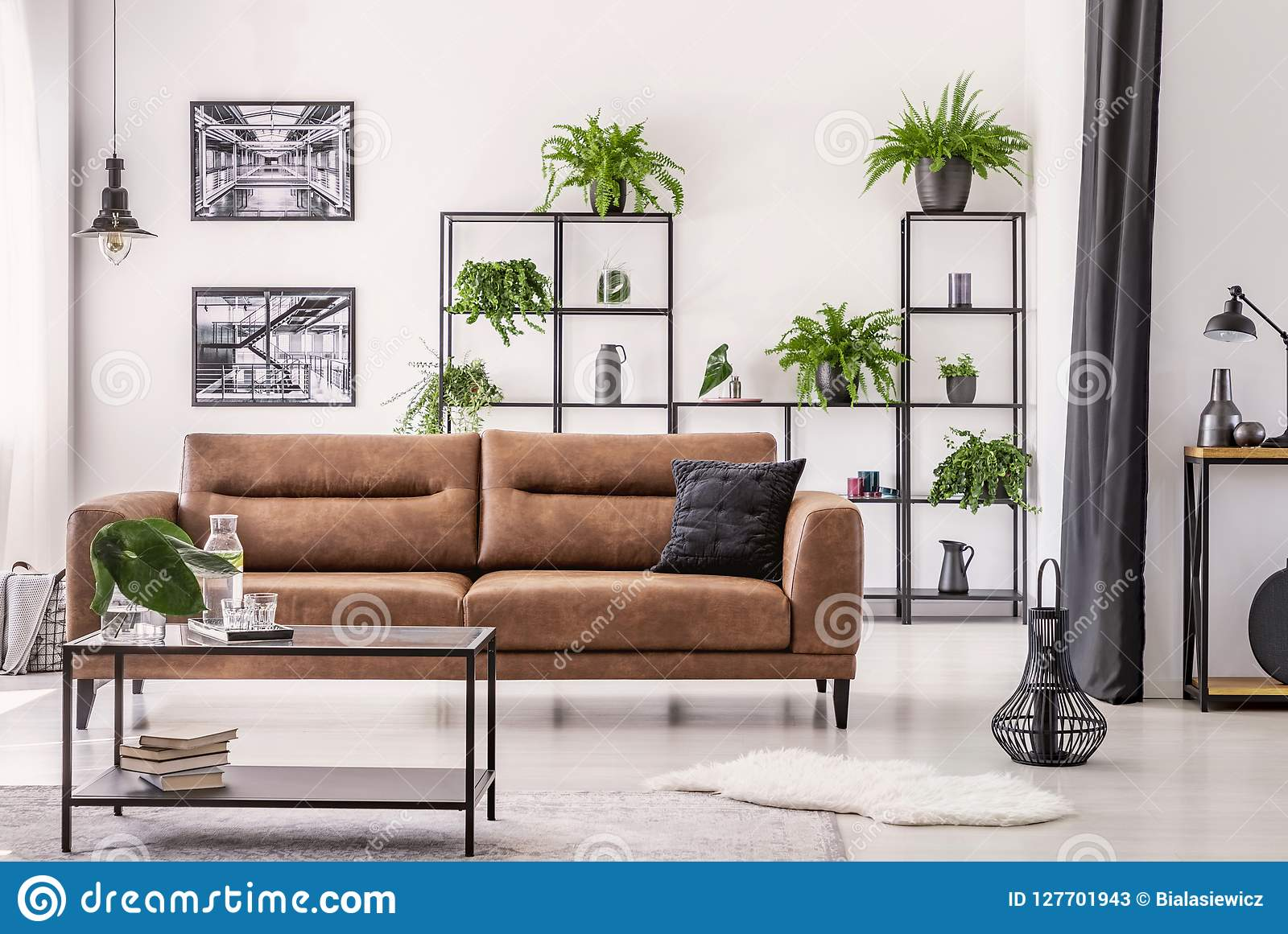 table in front of leather sofa in white apartment interior with lamp rh dreamstime com name of table in front of sofa dining table in front of sofa