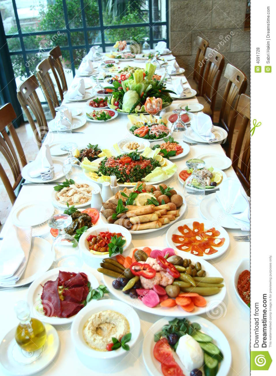 Table full of food stock photo. Image of delicious, dish