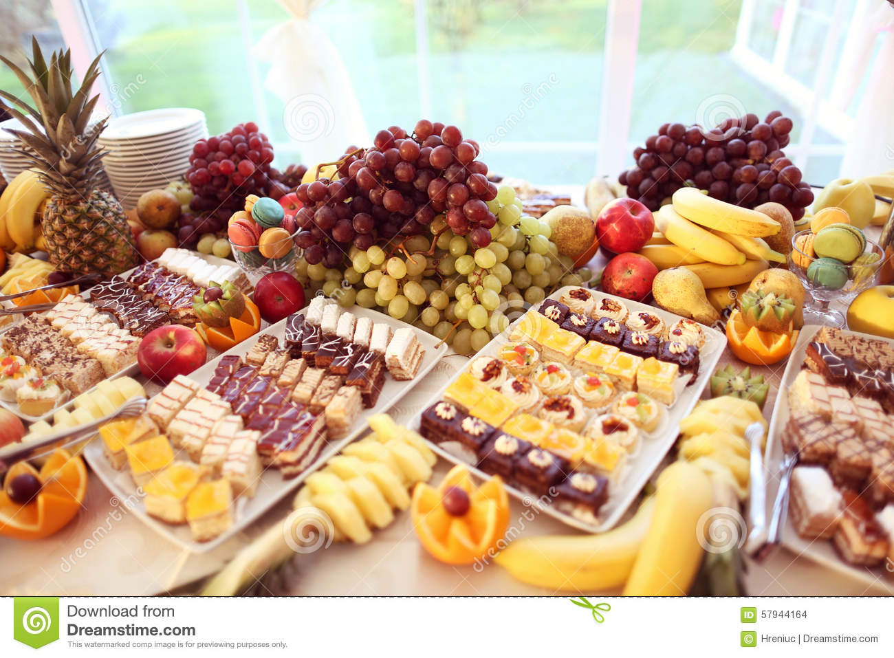 Table Full Of Fruits And Small Cakes Stock Photo Image