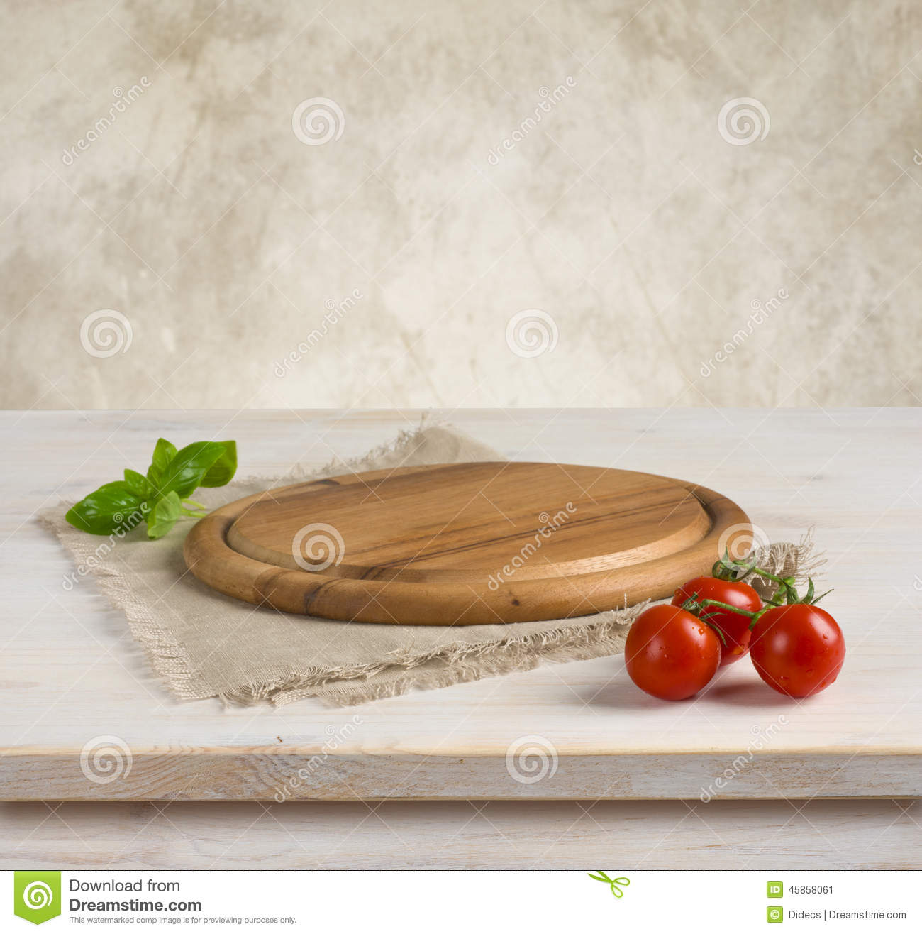 Kitchen Wall Background table and kitchen board over vintage wall background stock photo