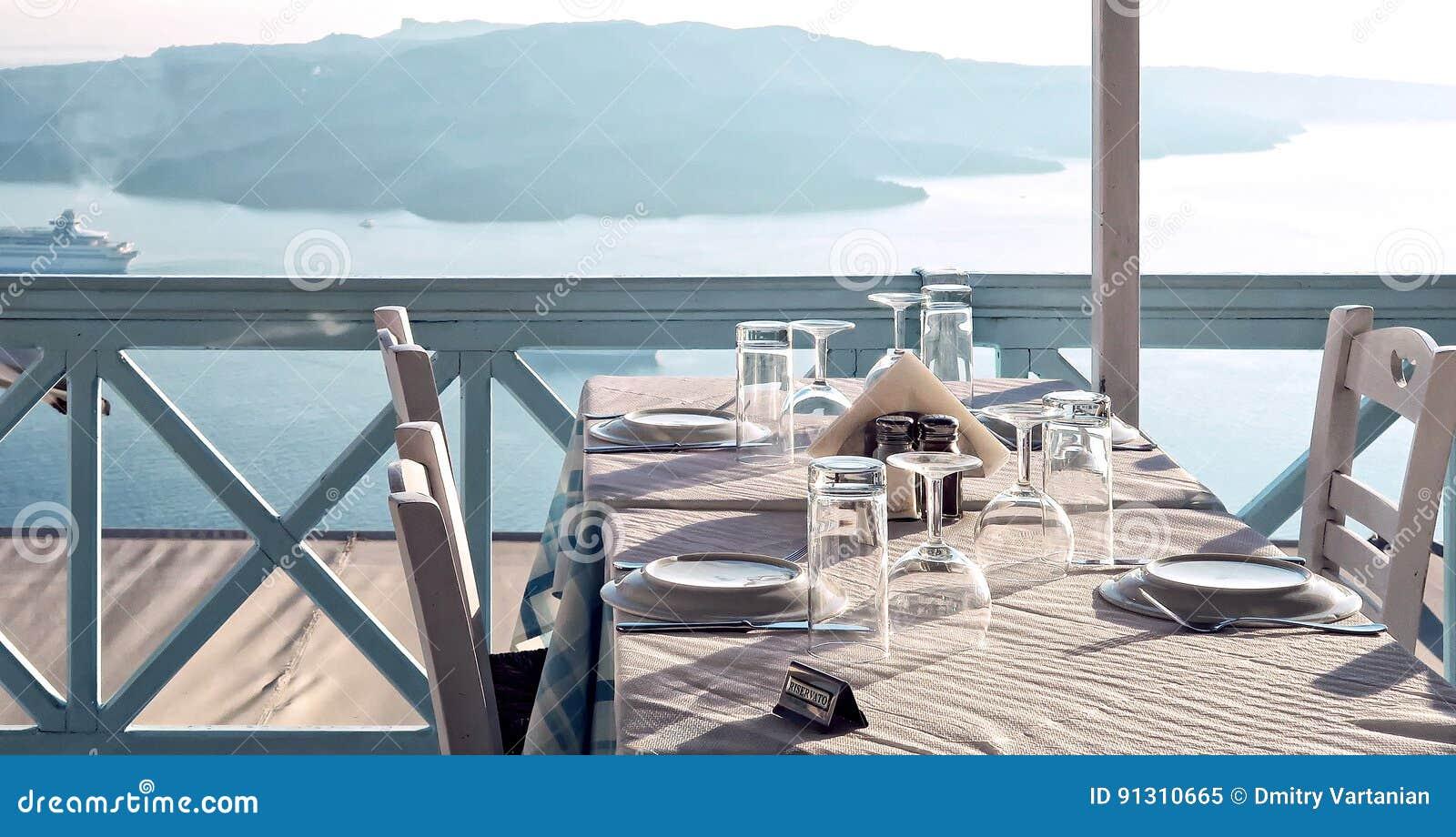 Table on patio, Thira, Santorini Island, Greece