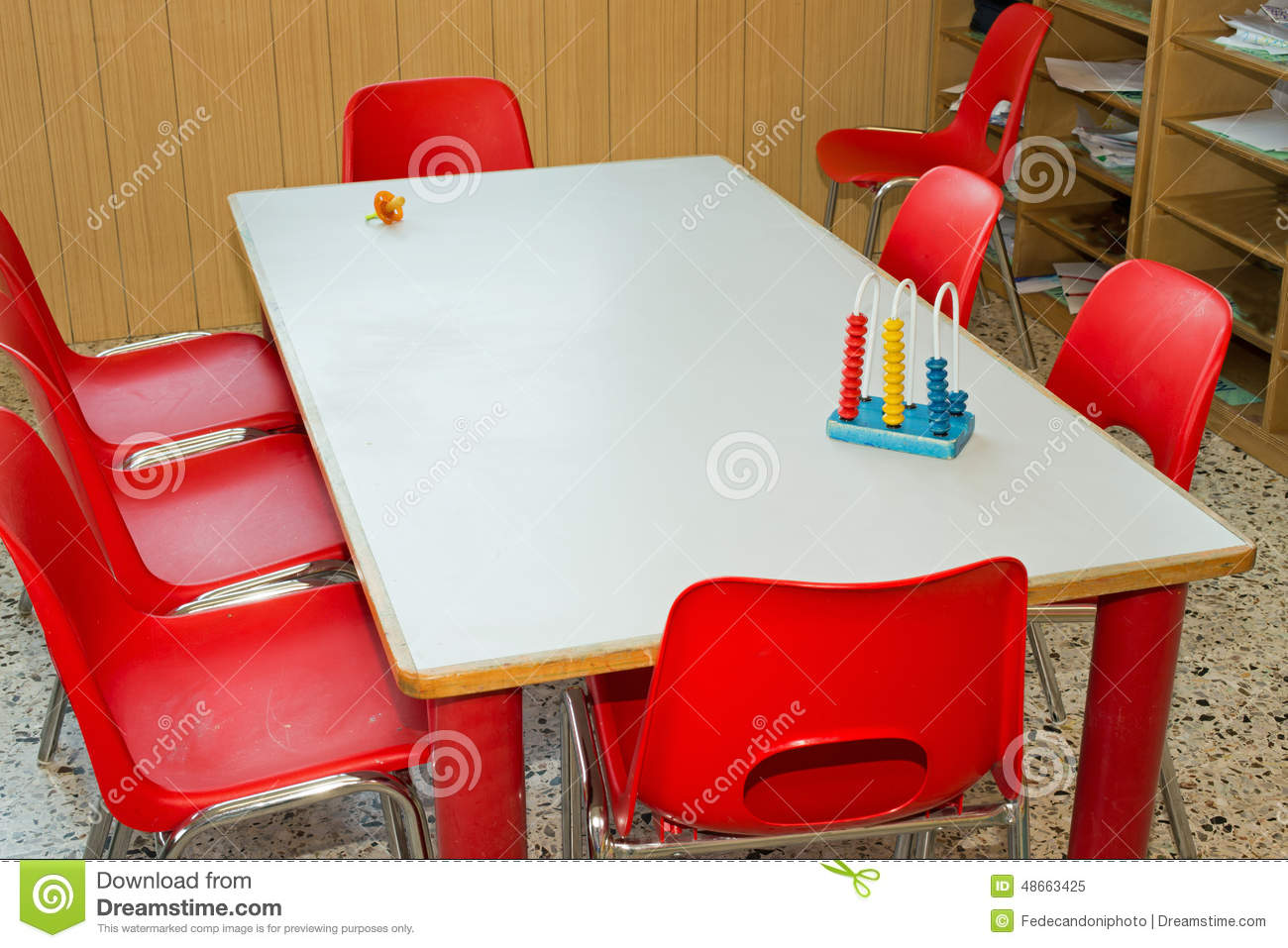 Table with red chairs of a school class for children stock - School bus table and chair ...