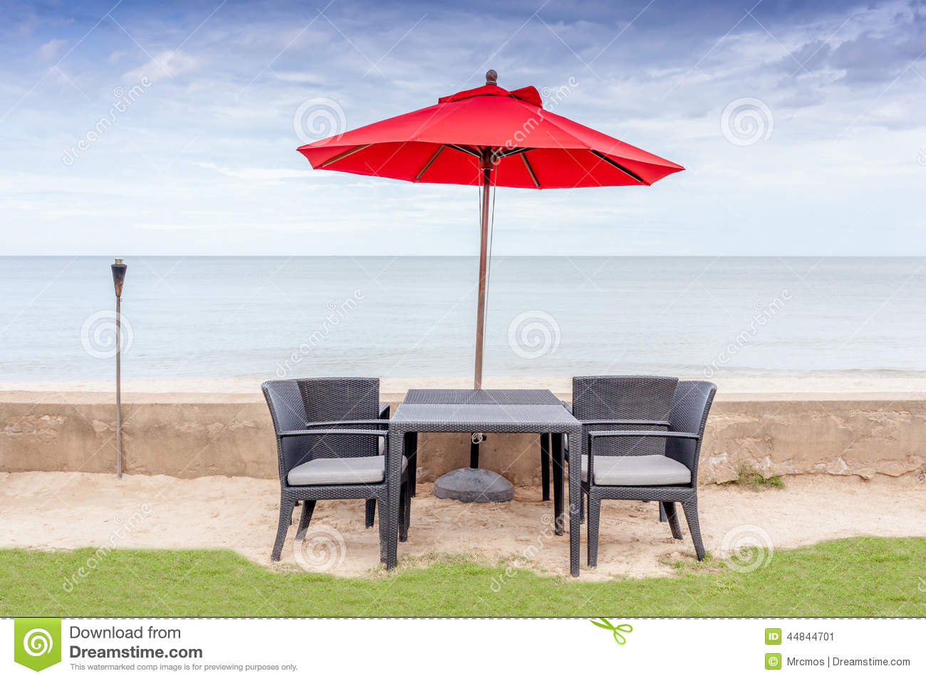 Beach chair and umbrella set - The Table Set Beach Chairs And Red Umbrella With Beautiful Beac Stock Image