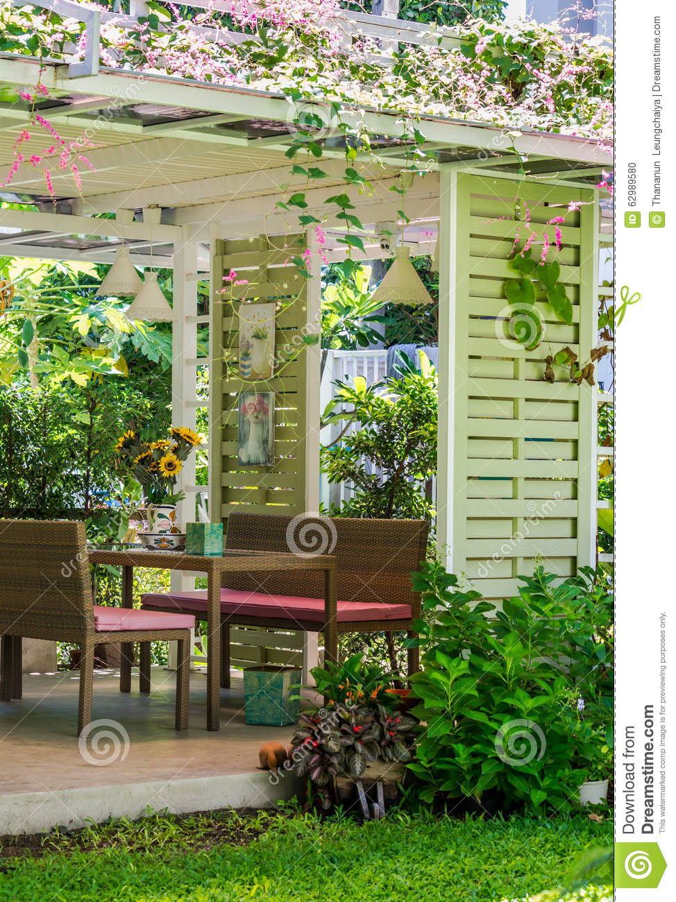 Table Set In Home Garden, Tree Fence Background.