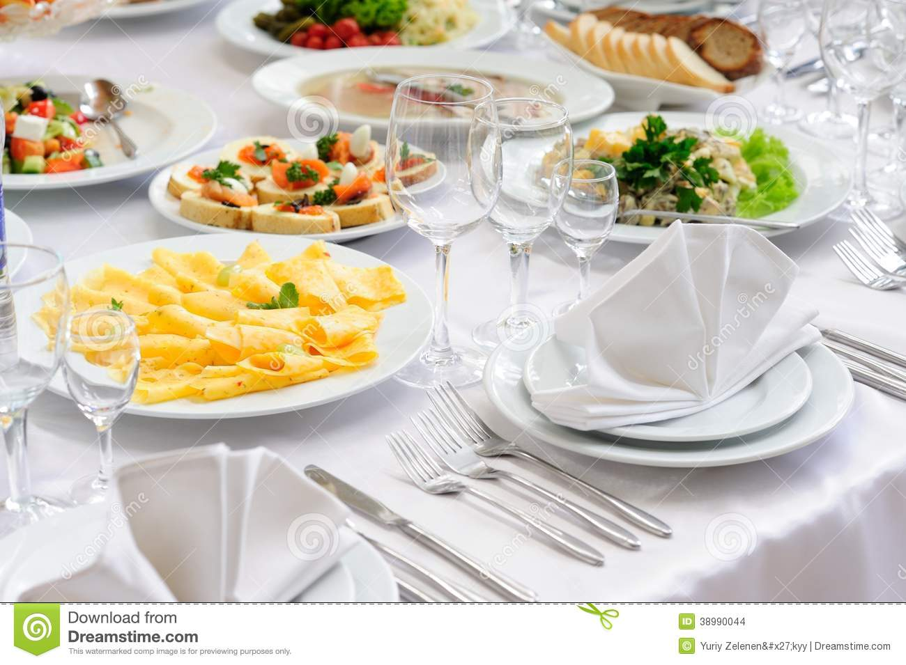Table set service with silverware and glass stemware at restaurant ...