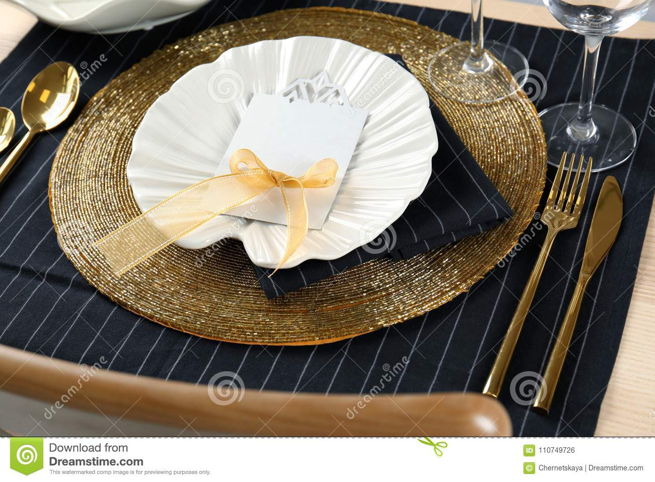 Table Setting In Black And Gold Color With Floral Decor Stock Photo