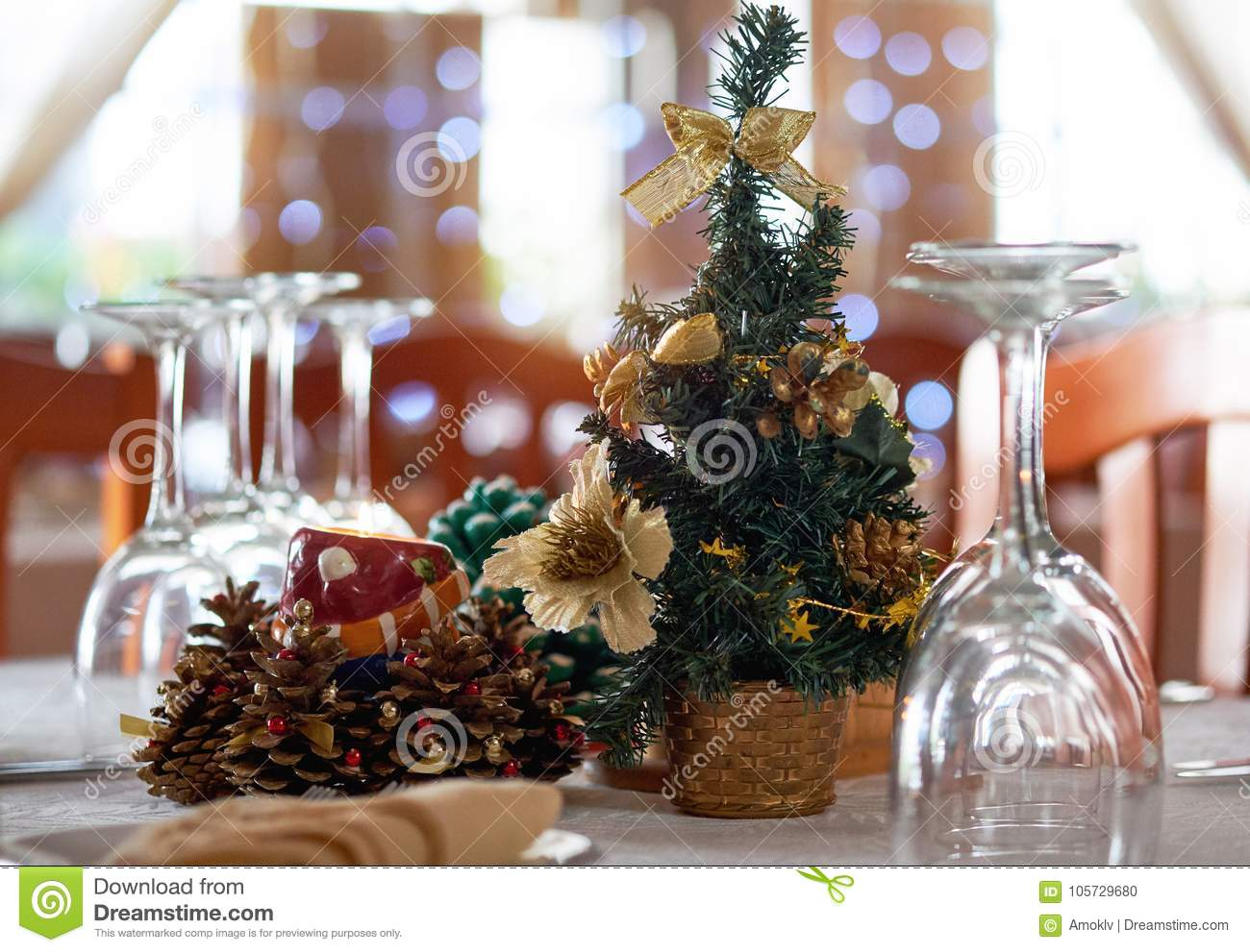 table setting with christmas decorations in a restaurant