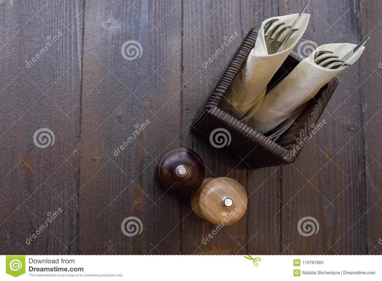 Table Setting On Dark Wooden Table Top View. Salt And Pepper Shakers ...
