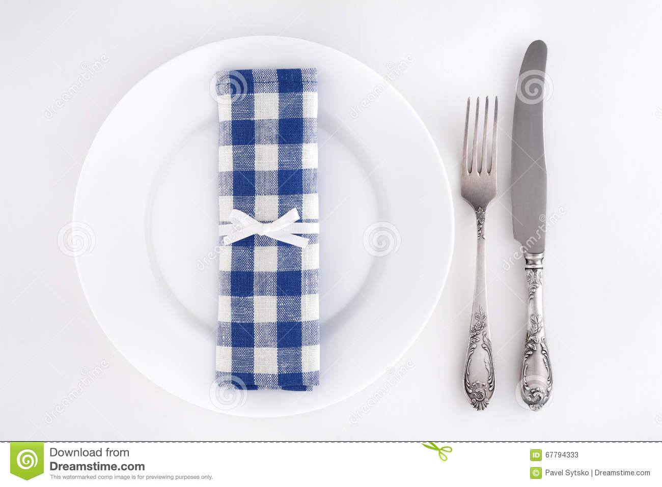 Table setting with fork knife and blue checkered napkin & Table Setting With Fork Knife And Blue Checkered Napkin Stock Image ...