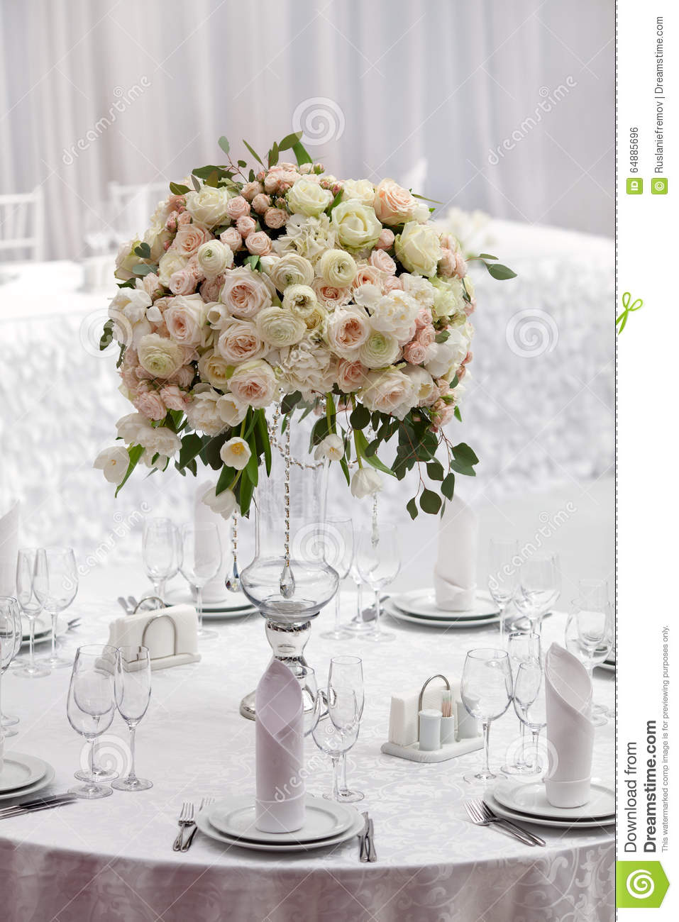 table setting at a luxury wedding reception beautiful flowers on the table