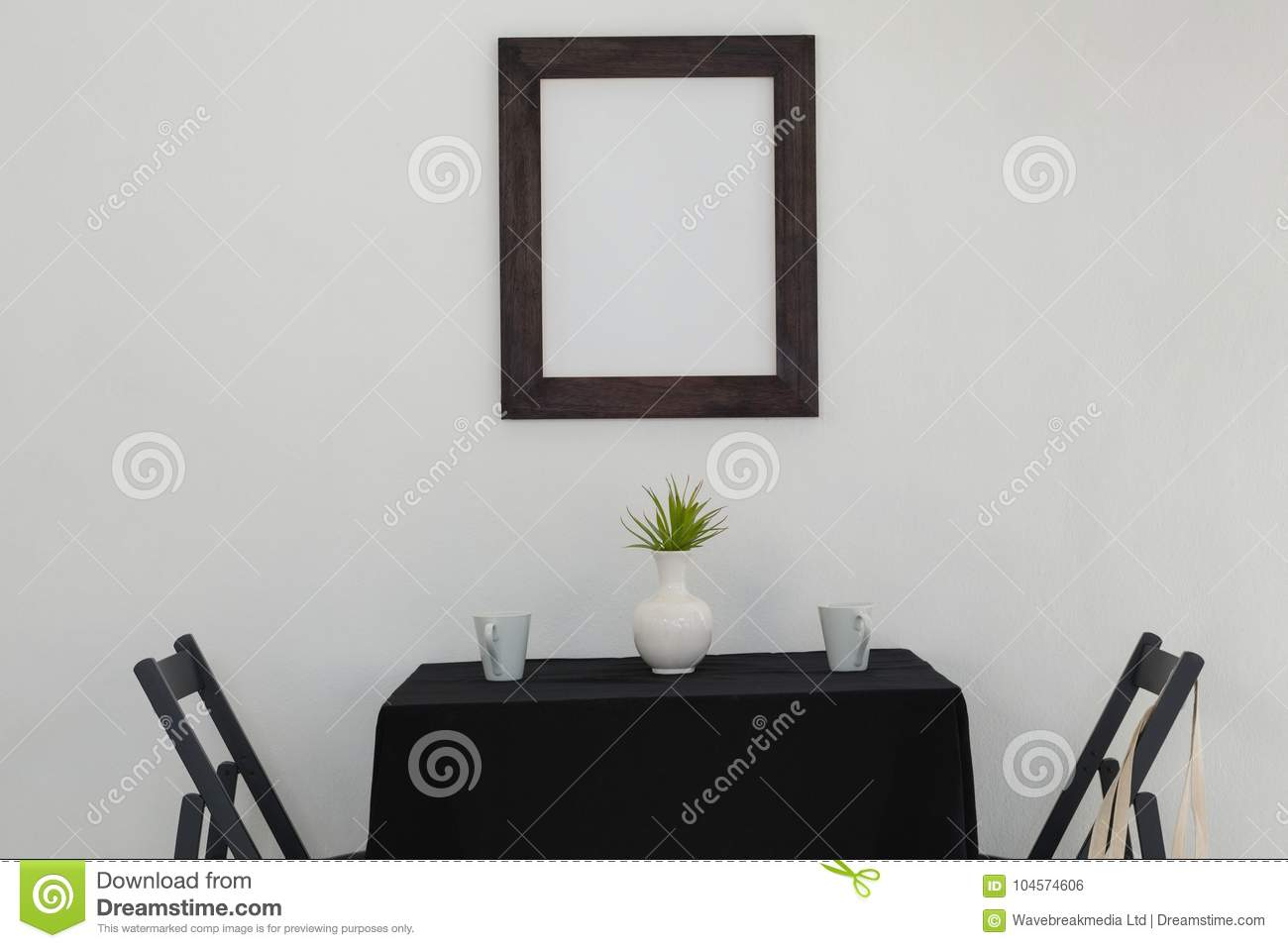 Table Setting And Picture Frame Stock Photo - Image of arranged ...