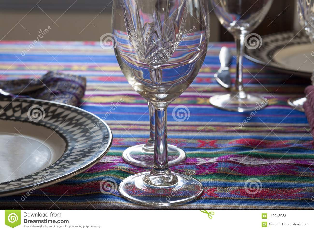 Table Setting With Plates And Glassware Stock Image - Image of table ...