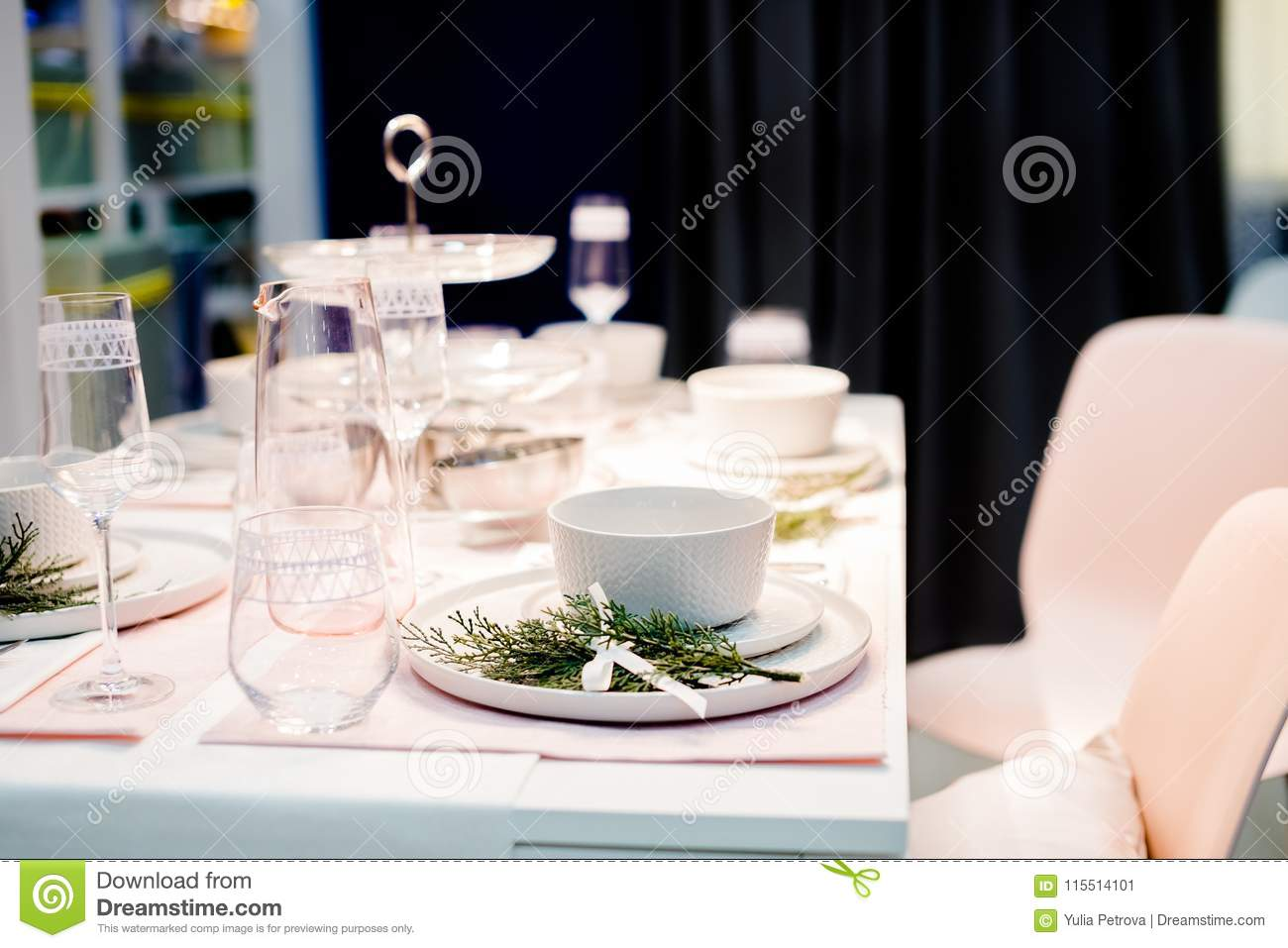 Table Setting In White Color With Decoration Of Green Table