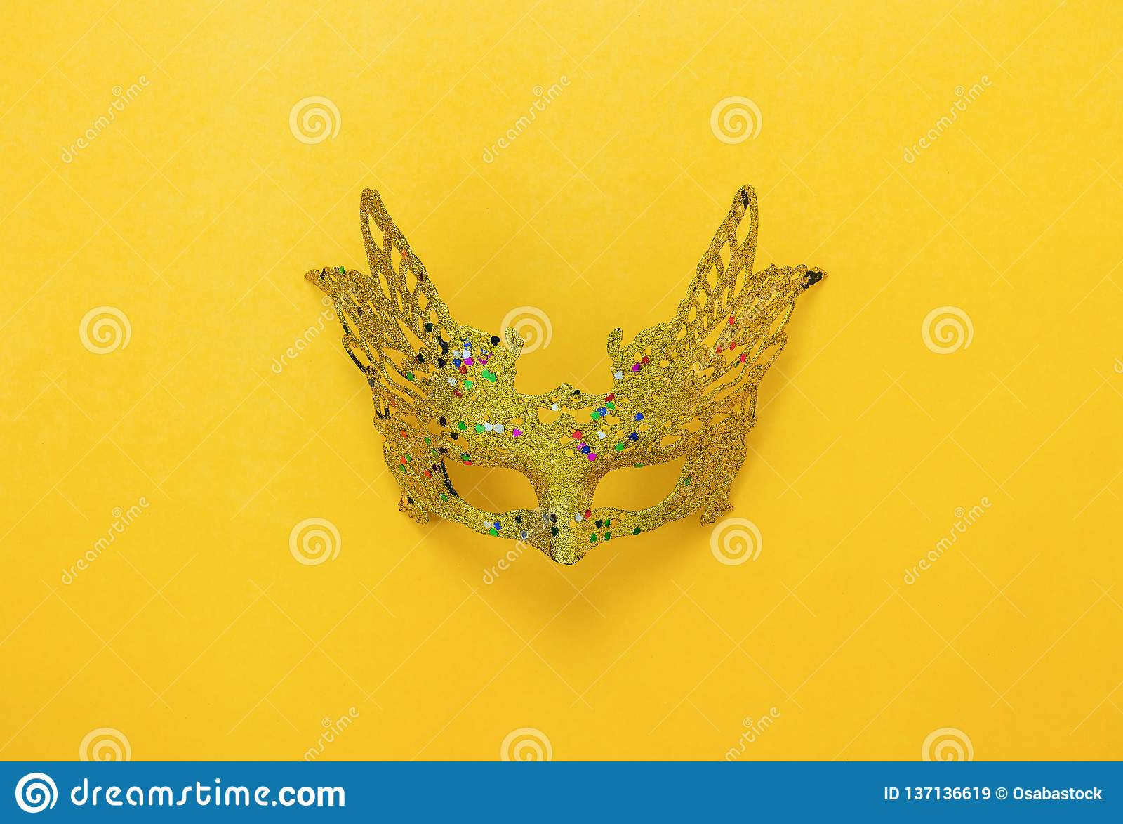 Table top view aerial image of beautiful colorful carnival season or photo booth prop Mardi Gras background.Flat lay object gold