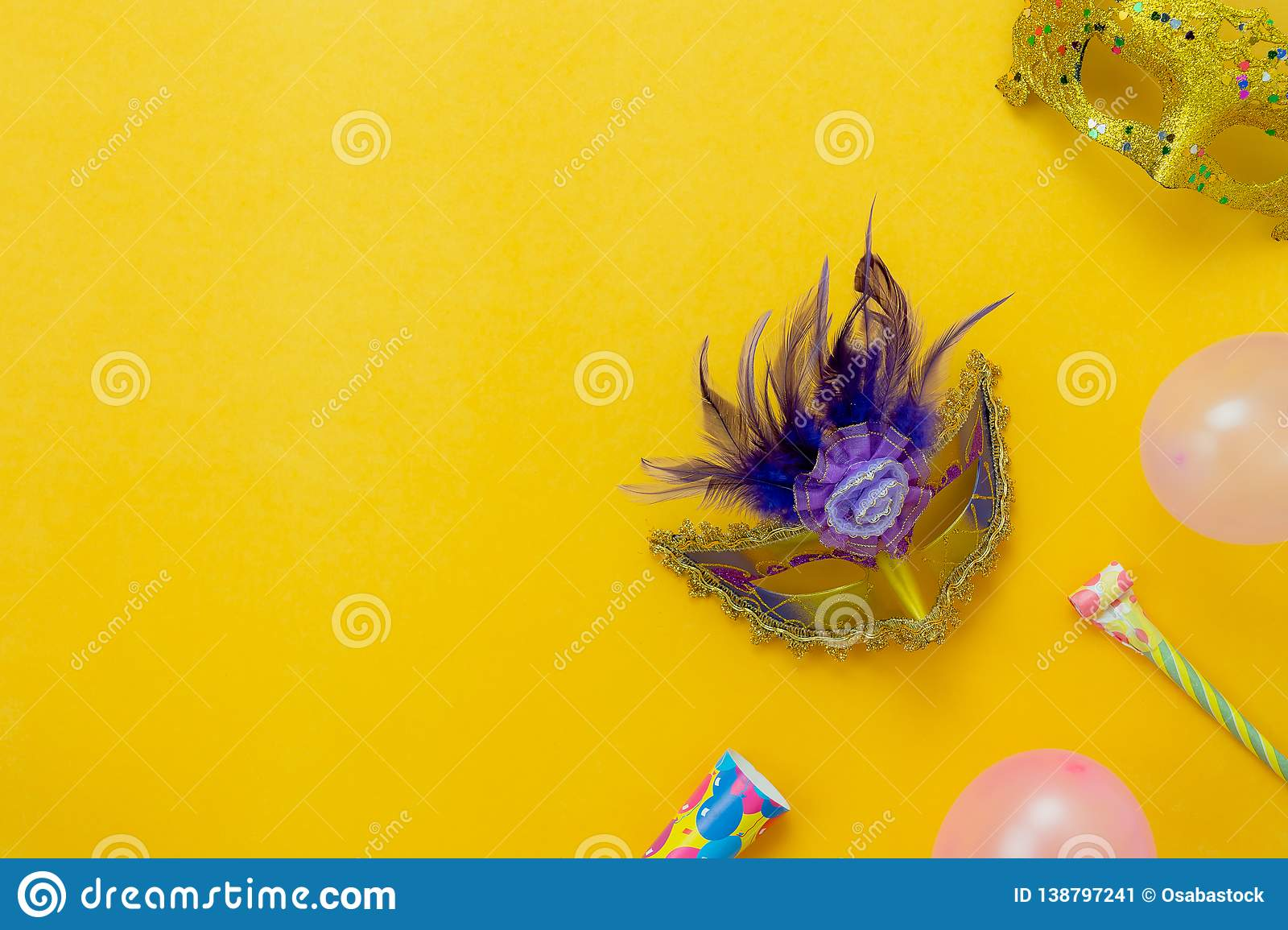 Table top view aerial image of beautiful colorful carnival season or photo booth prop Mardi Gras background.