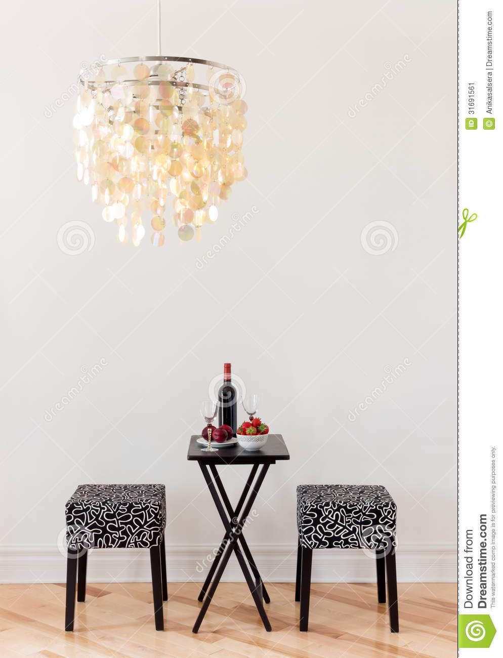 Table for two with bottle of red wine
