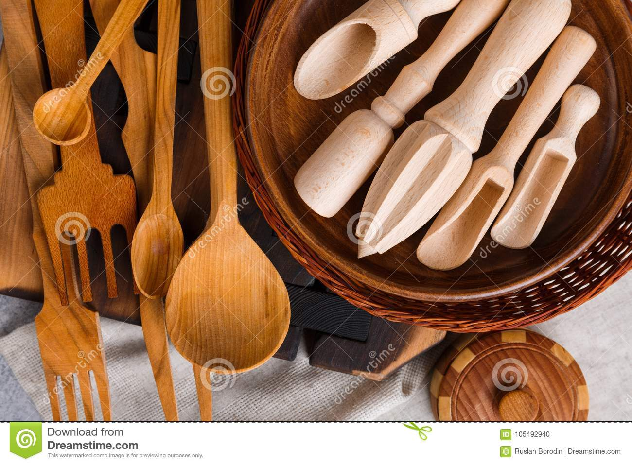 On the table are various wooden kitchen utensils view for Table utensils