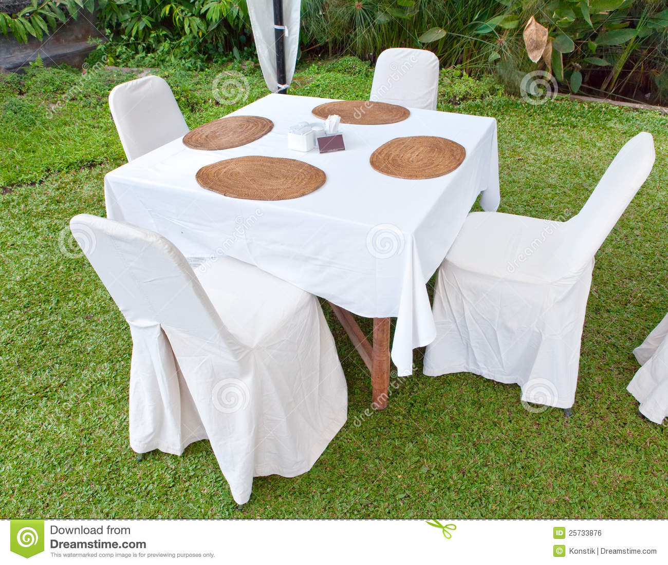 Table with a white cloth and 4 chairs