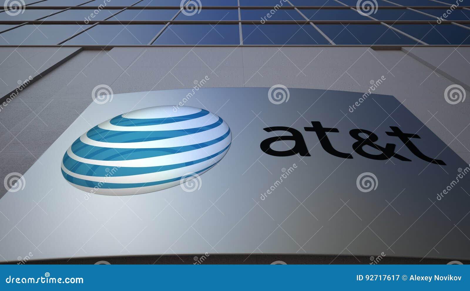 Tablero al aire libre de la señalización con American Telephone y Telegraph Company EN el logotipo de T Edificio de oficinas mode