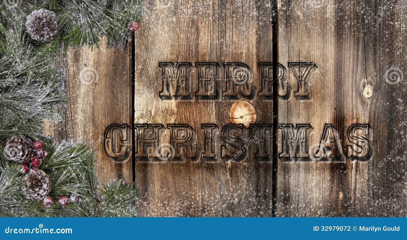 Tableros rústicos de la Feliz Navidad