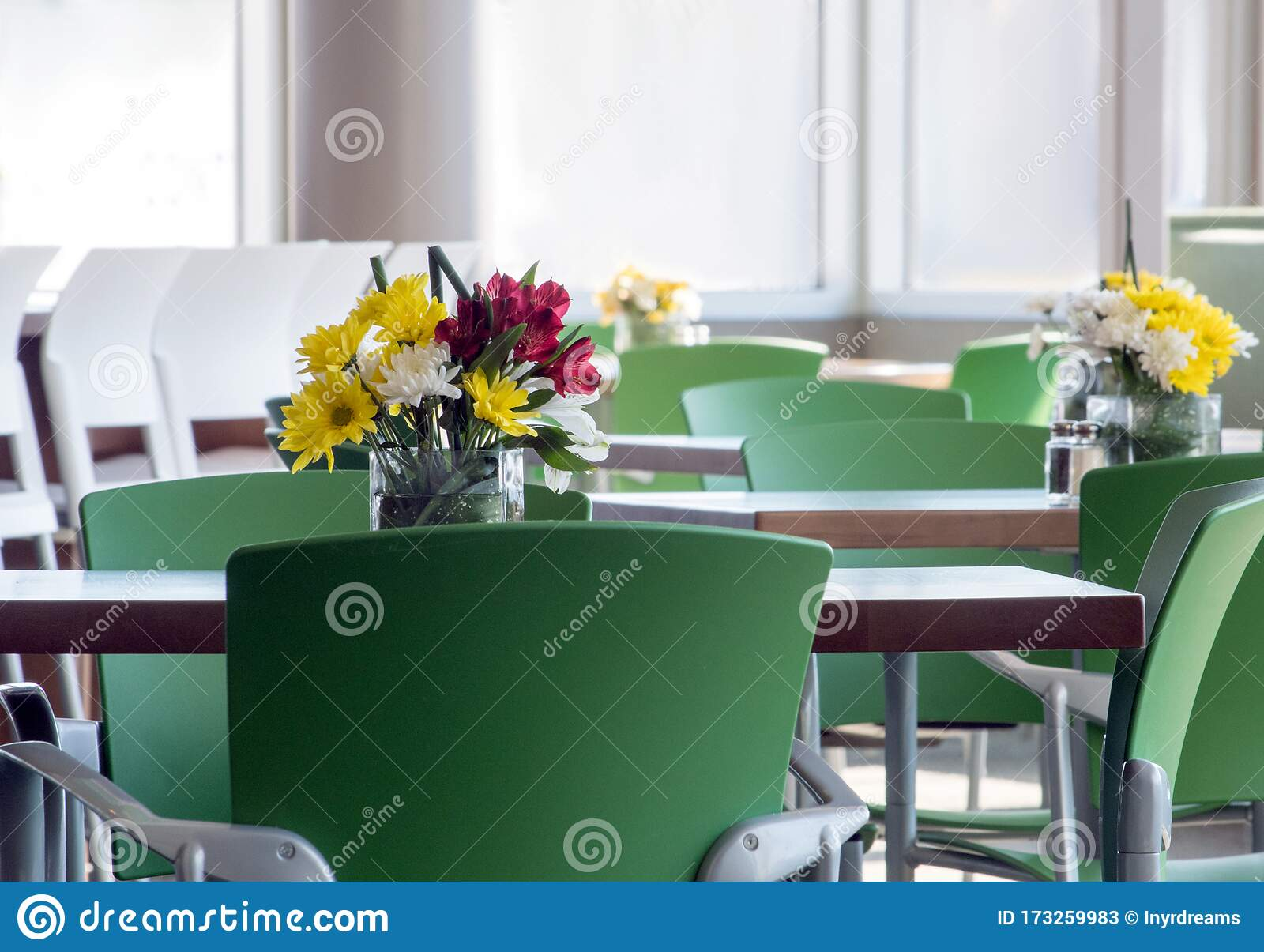 Tables And Chairs With Pretty Flower Centerpieces Stock Image Image Of Date Empty 173259983