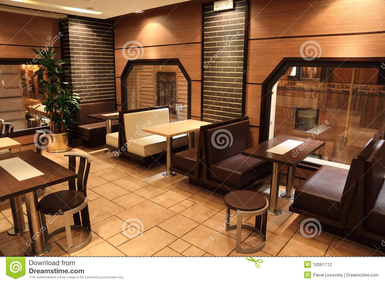 Tables Chairs And Windows In Small Restaurant Stock