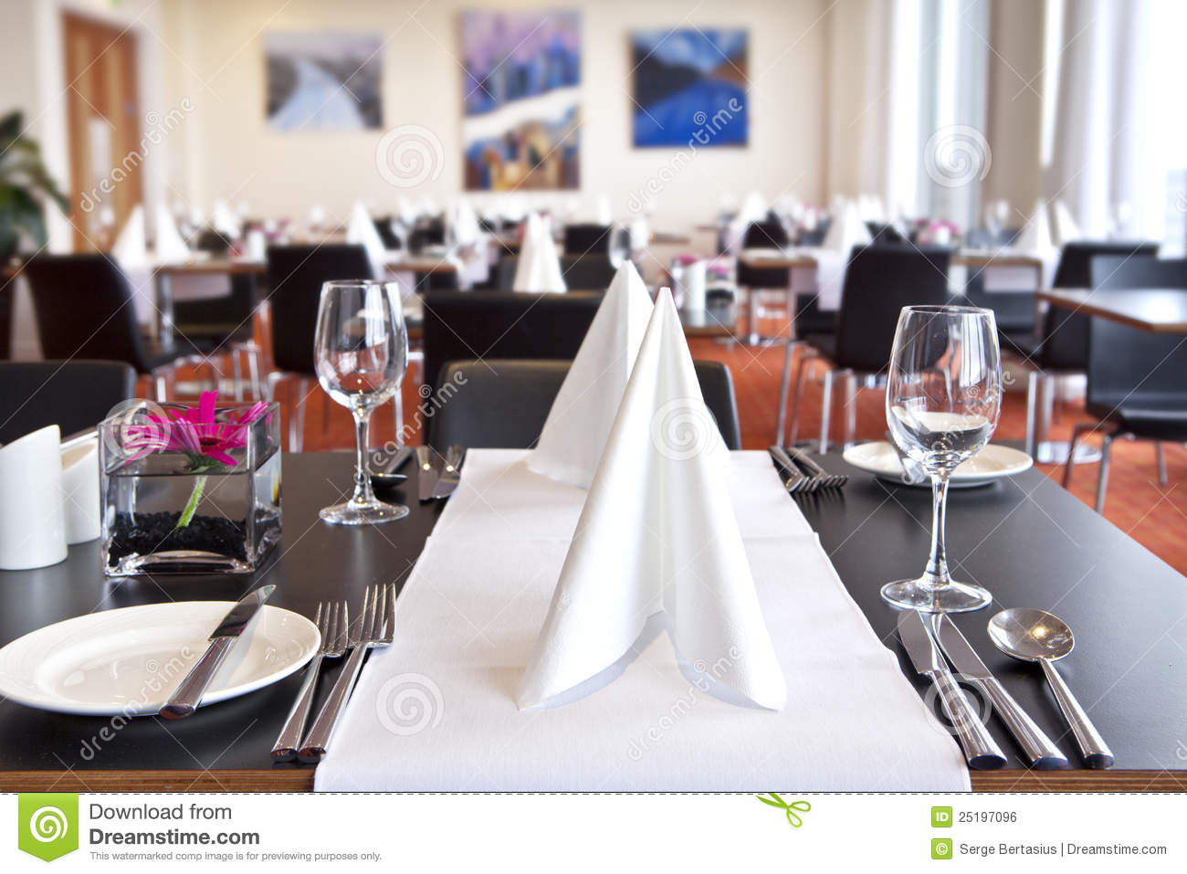 Tables with formal setup in modern restaurant stock photo