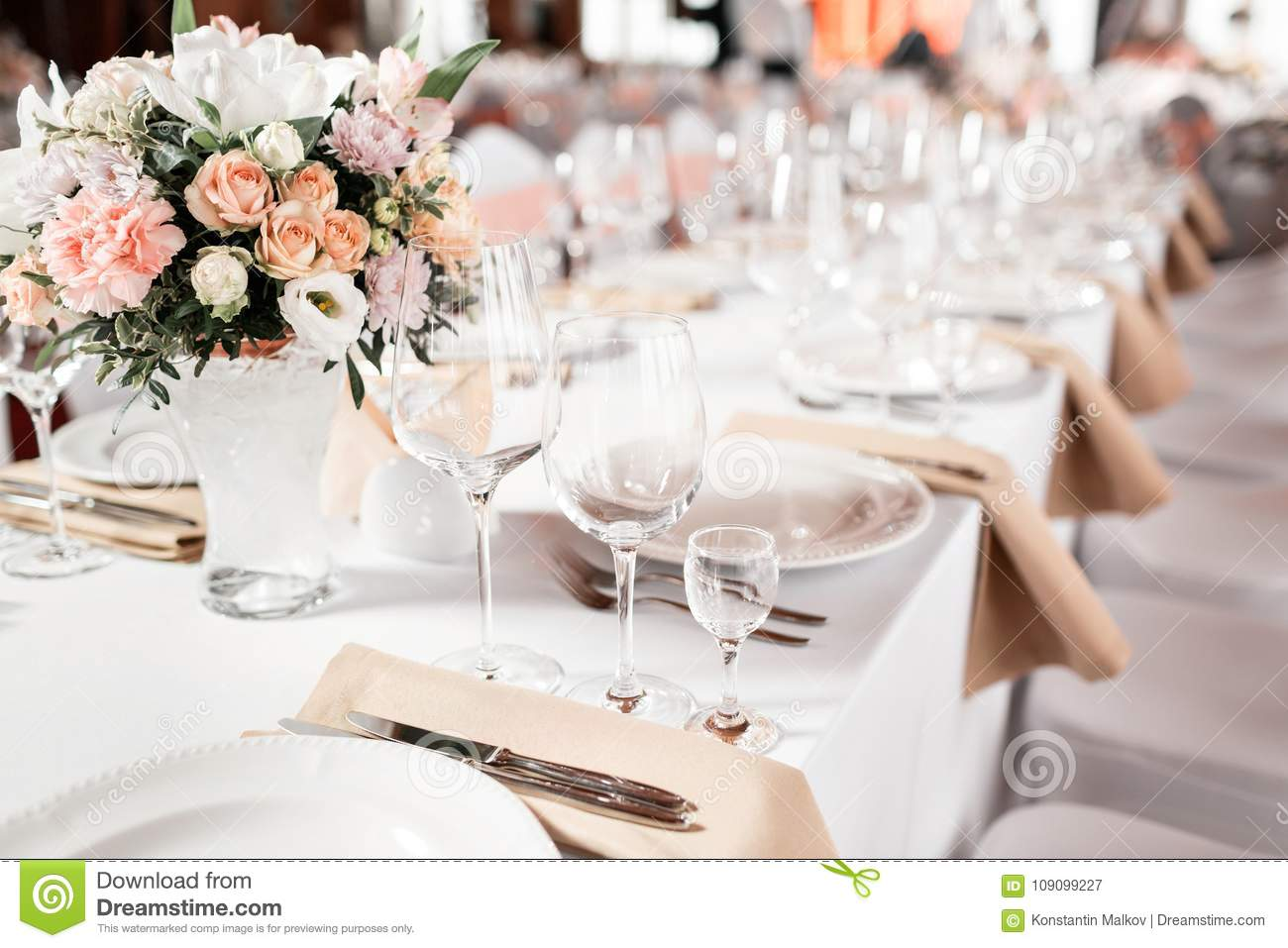 Tables set for an event party or wedding reception. luxury elegant table setting dinner in a restaurant. glasses and