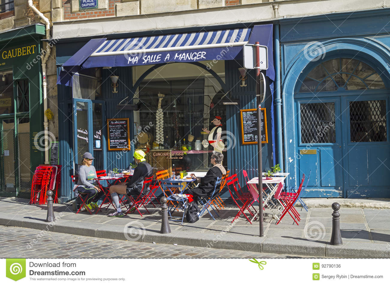Tables On The Sidewalk In Front Of A Small Cafe Paris France