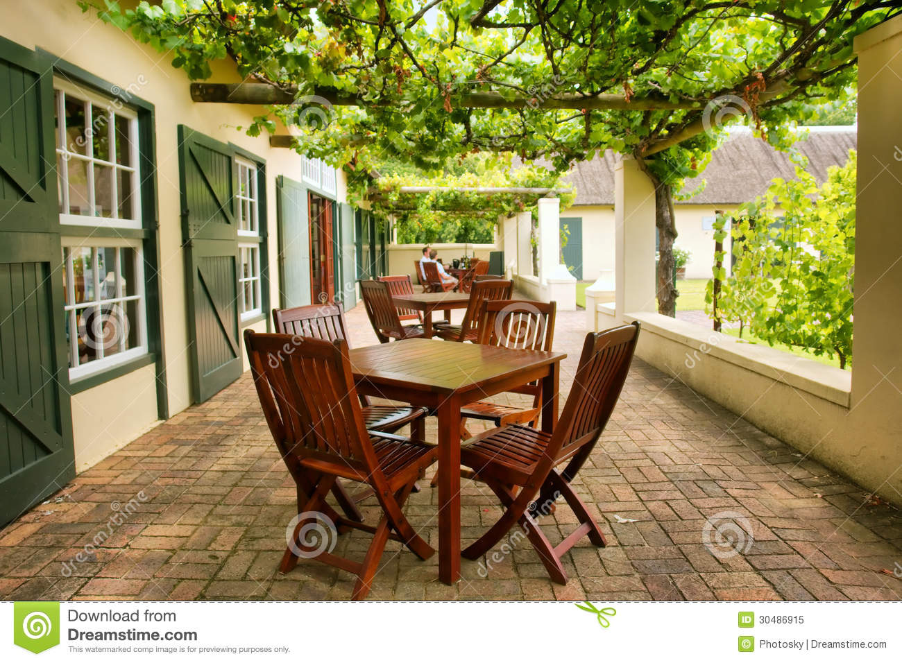 Tables on terrace covered by grape vine royalty free stock for 18 terrace street orange ma