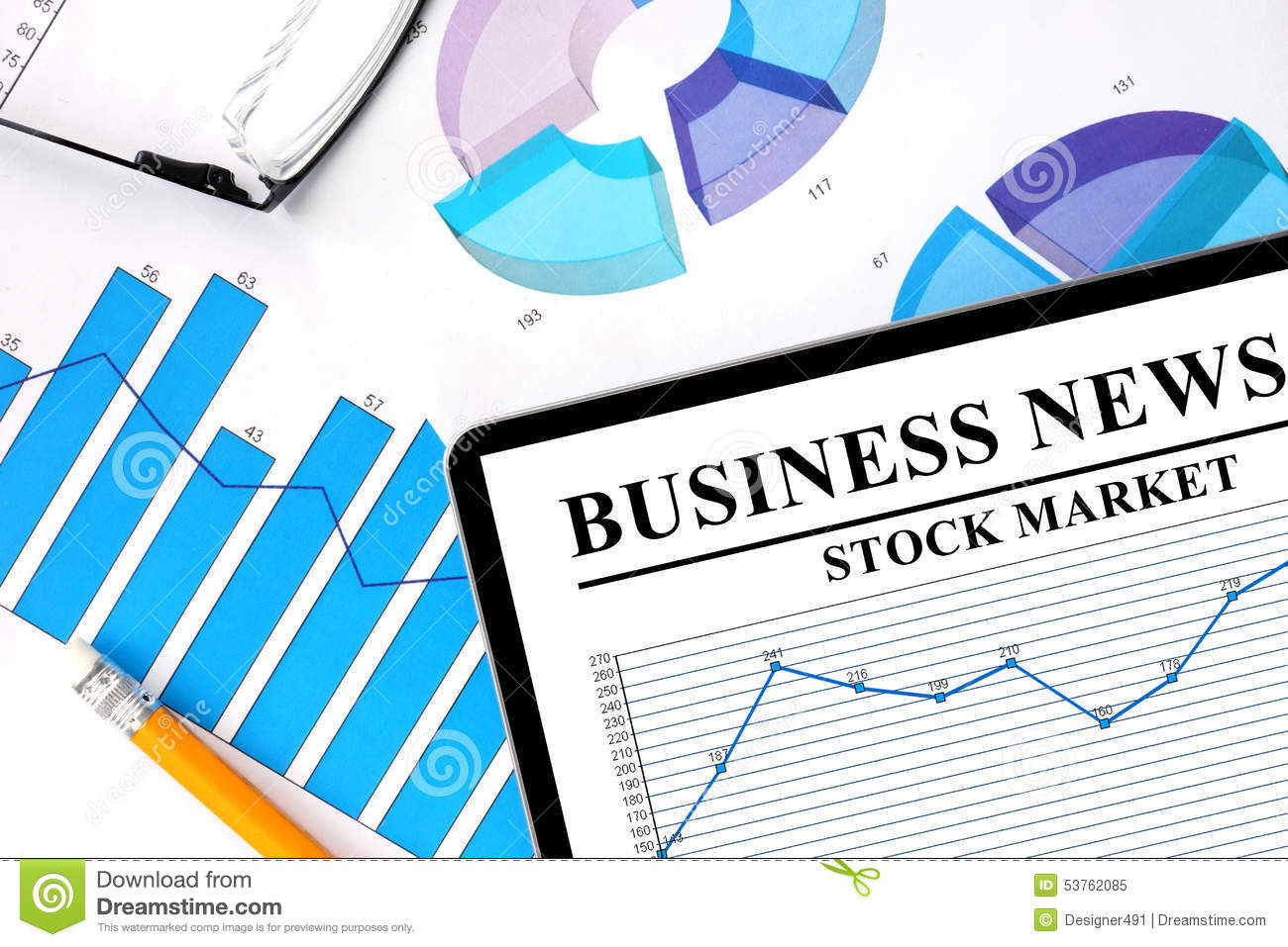 tablet with business news of stock market stock photo