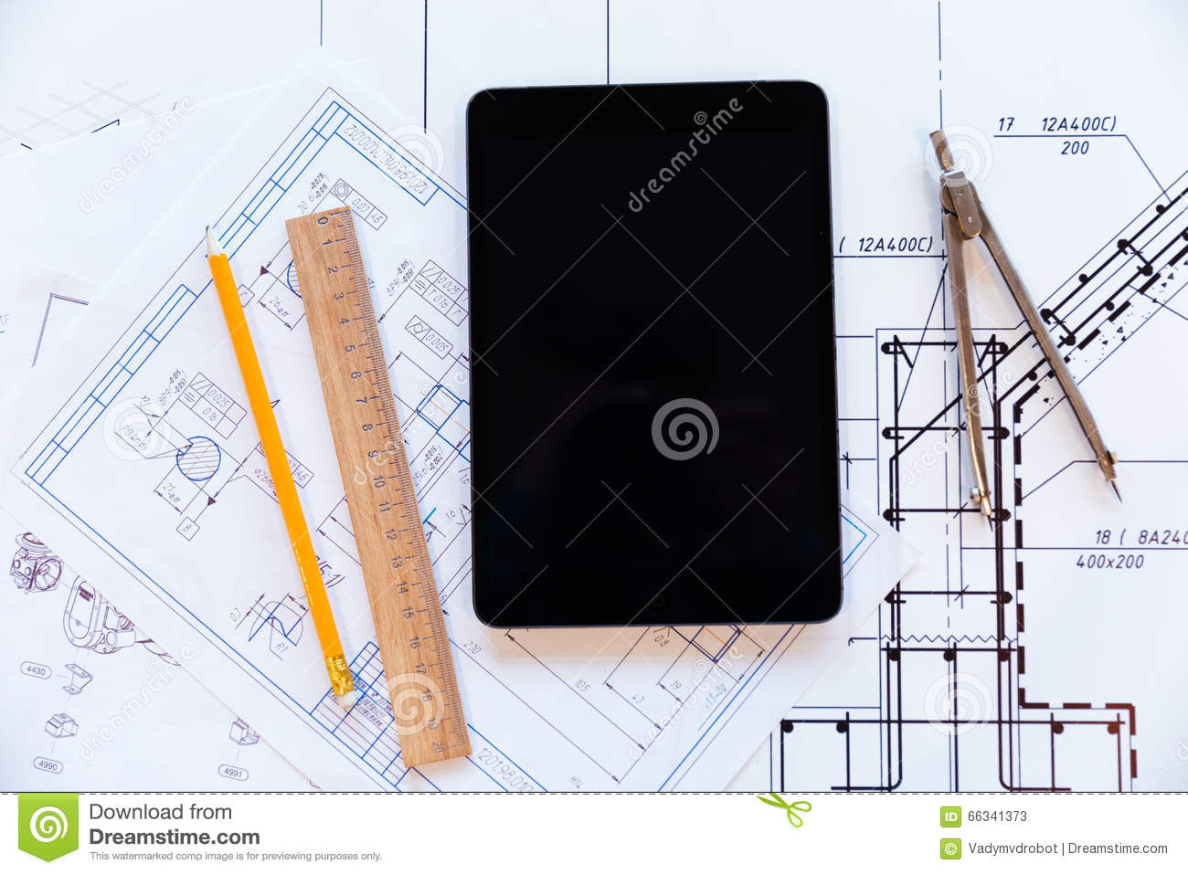Tablet computer and paper with blueprints stock image image of tablet computer and paper with blueprints malvernweather Images