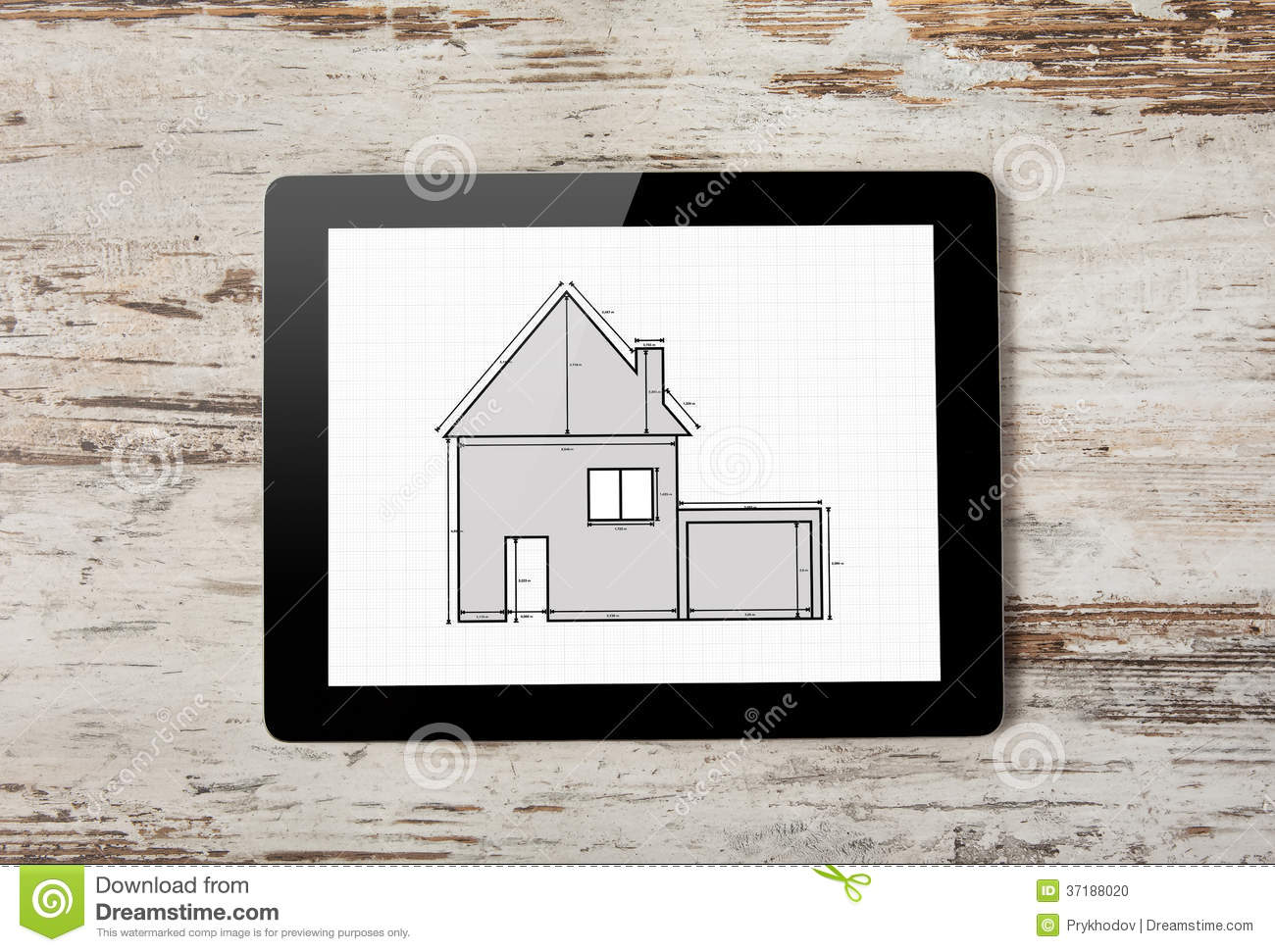 Tablet with drawing of apartment house on the screen on a background of wood