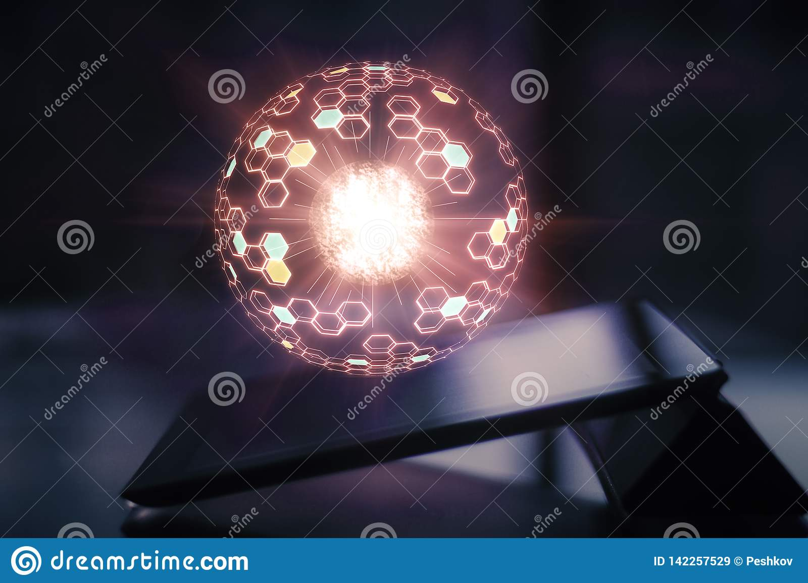 Tablet with glowing sphere