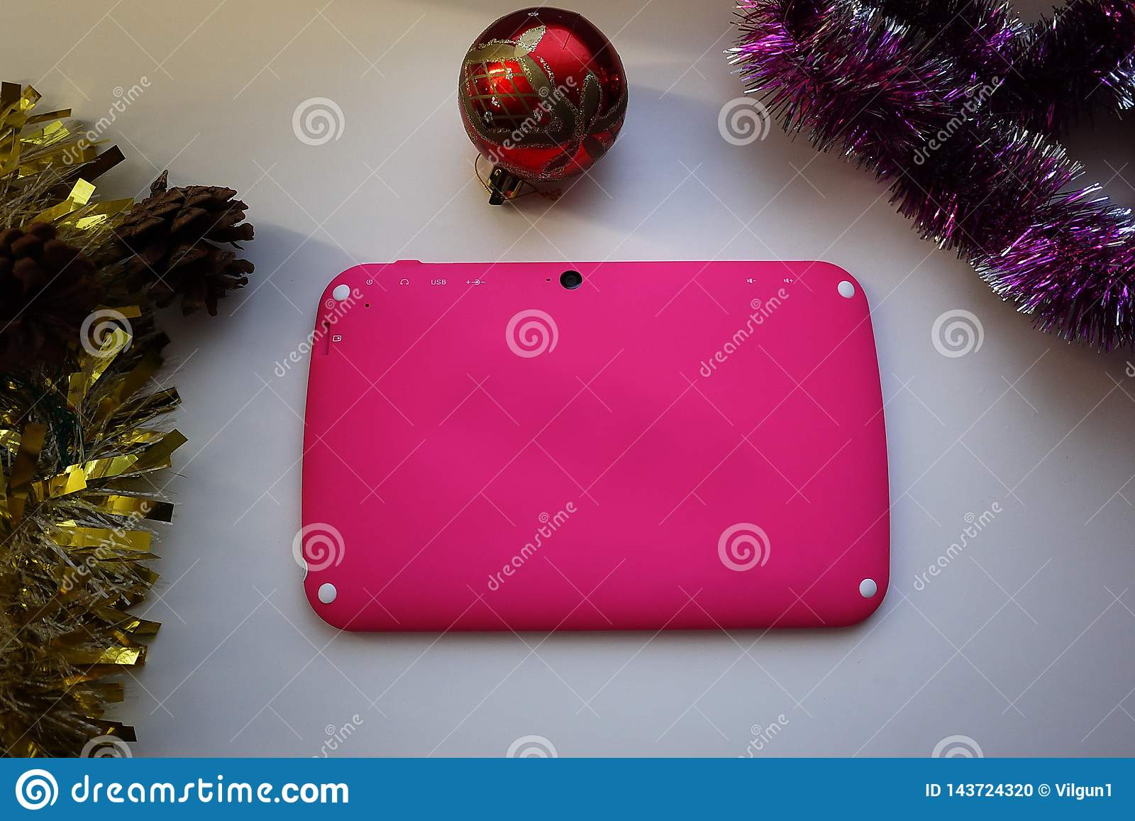 Tablet in the hands of a child. Tablet with a bright cover