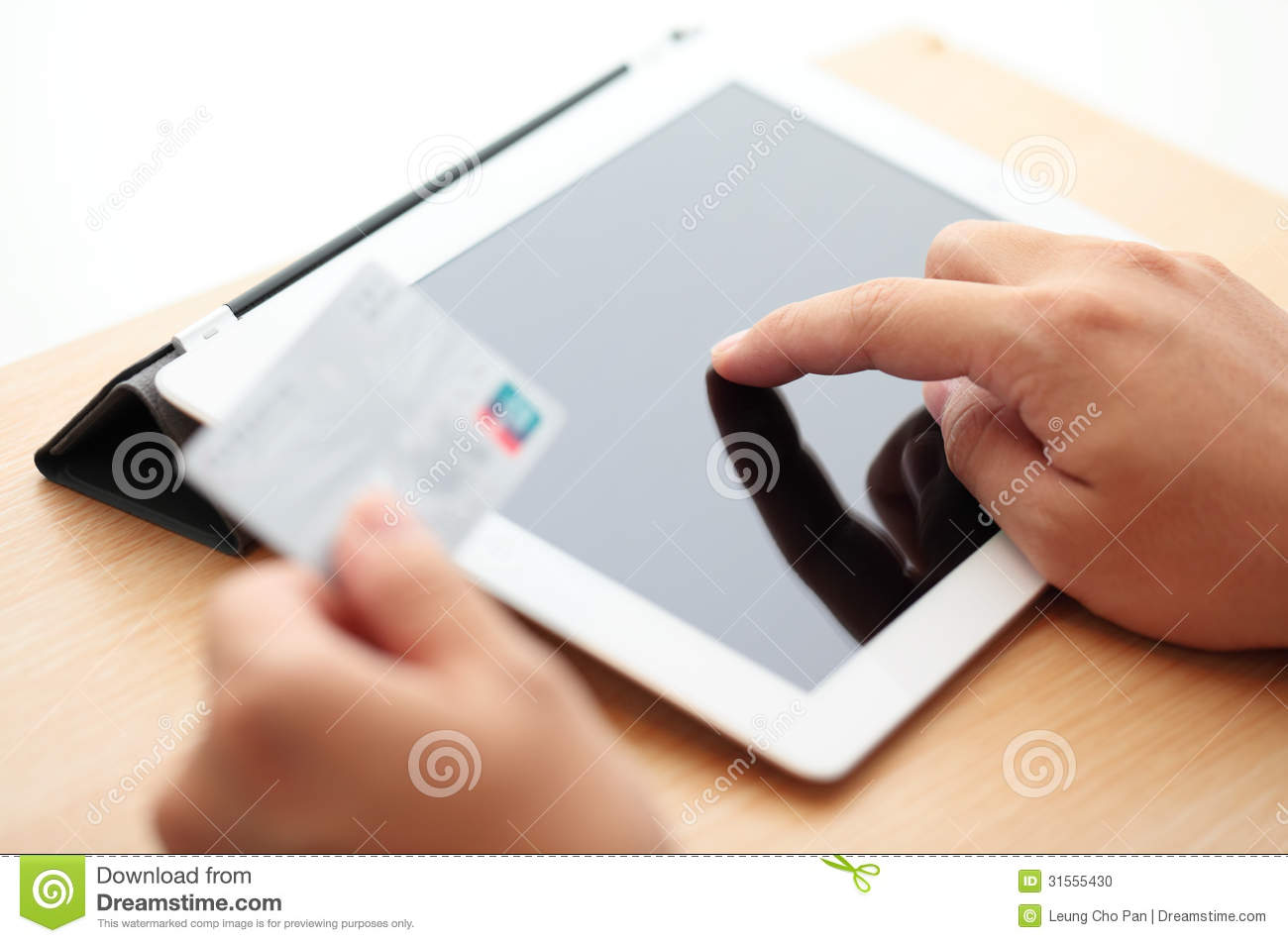 tablet online shopping with credit card stock photo